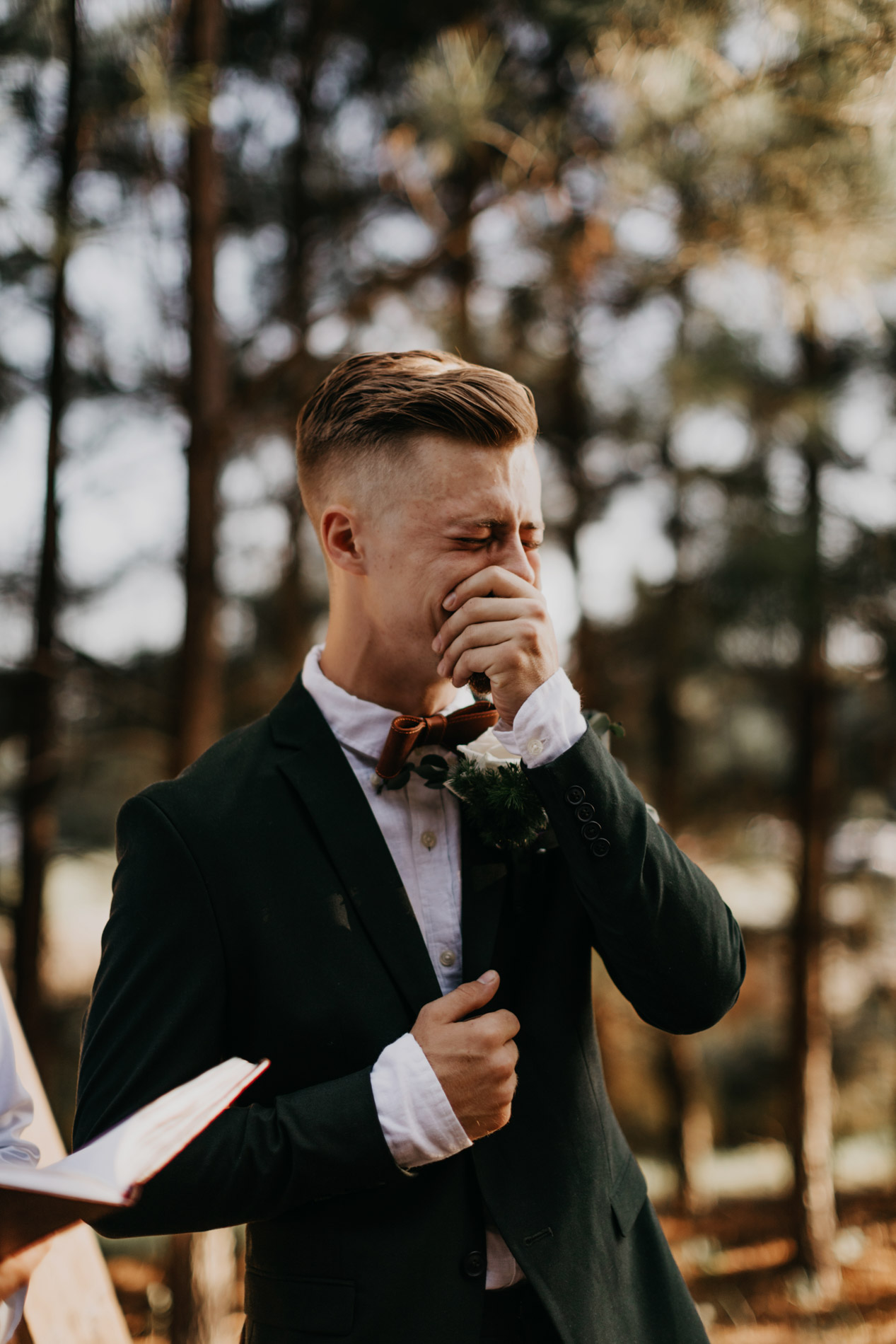 Groom seeing bride for first time walking down the aisle