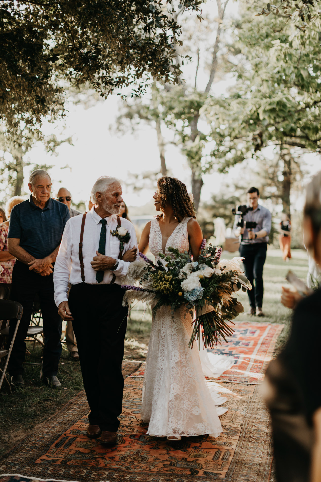 Bride being walked down aisle by grandad