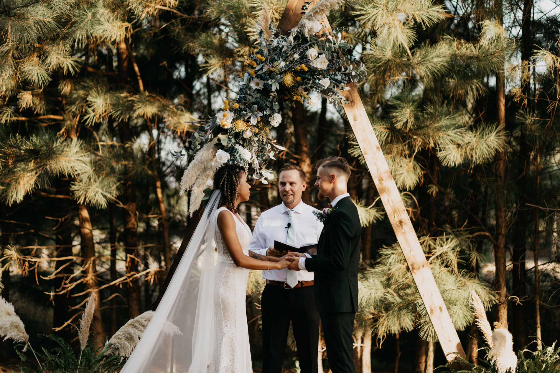 Bride and groom during bohemian wedding ceremony