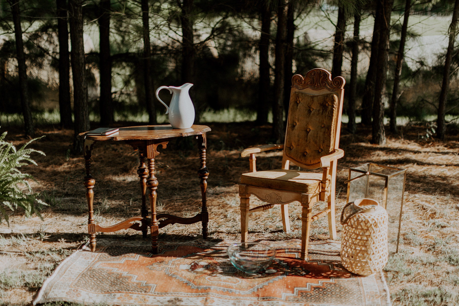 Vintage chair and table used for washing feet in wedding ceremony