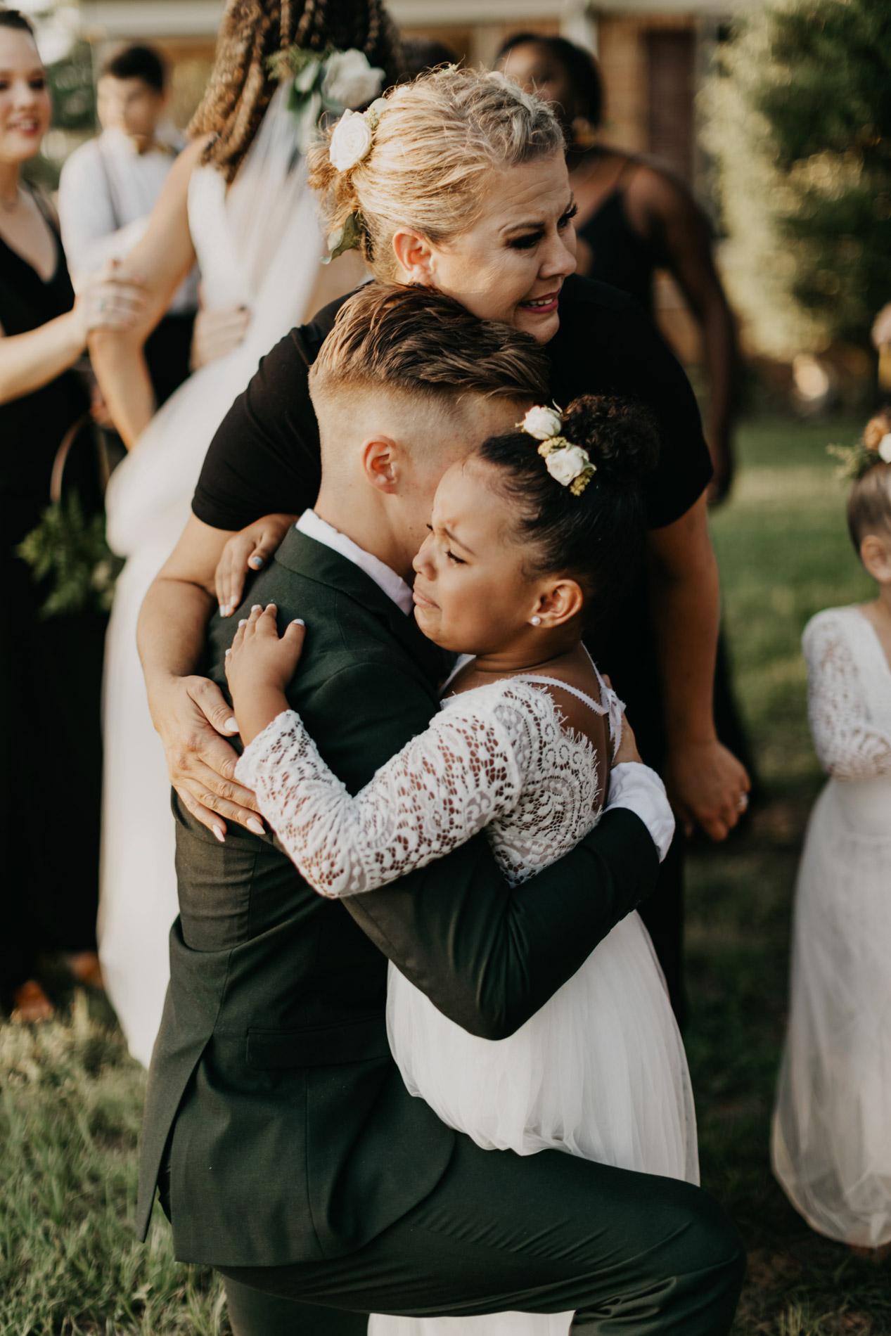 Groom hugging his new family members