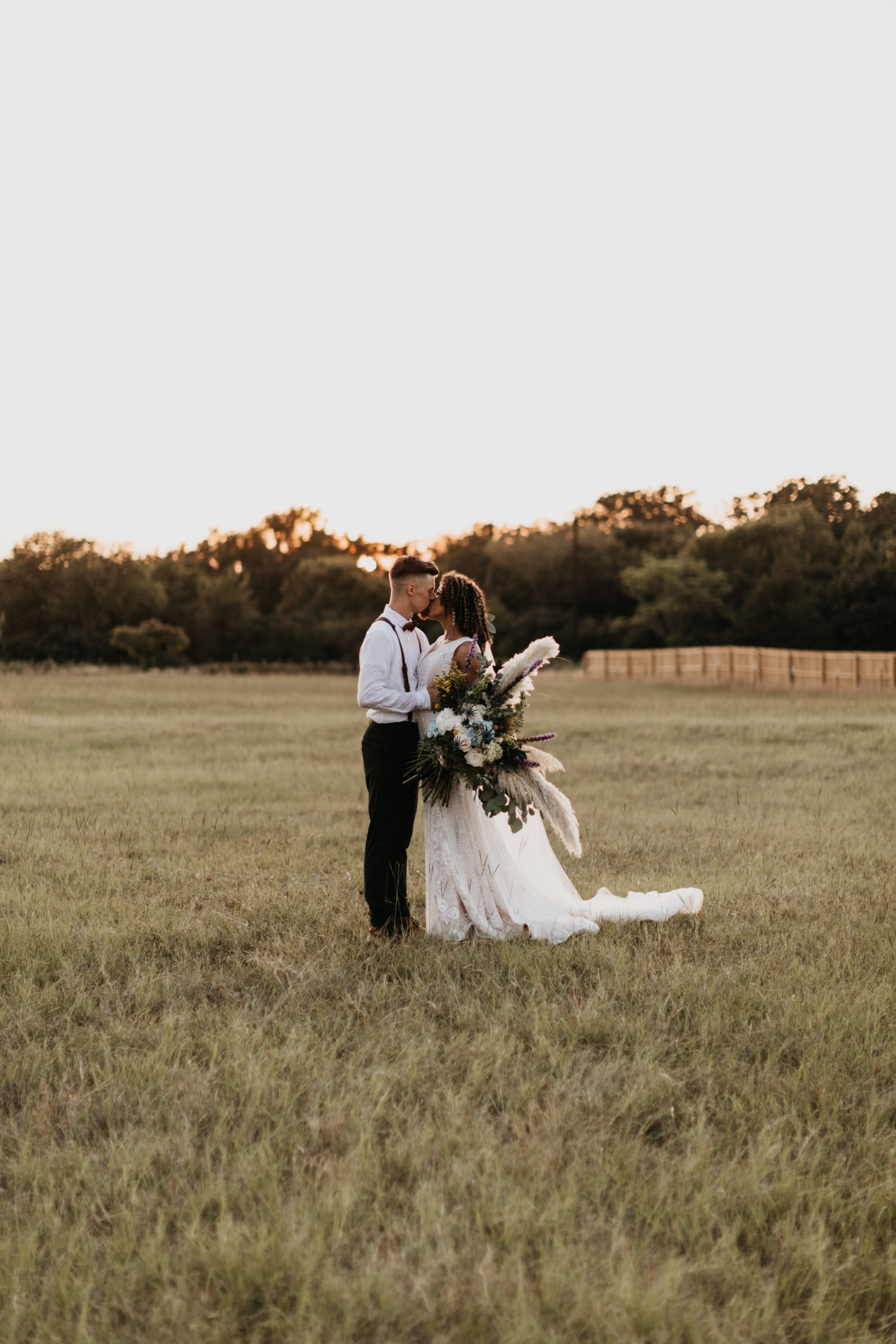 Bride and groom kissing on East Texas wedding day
