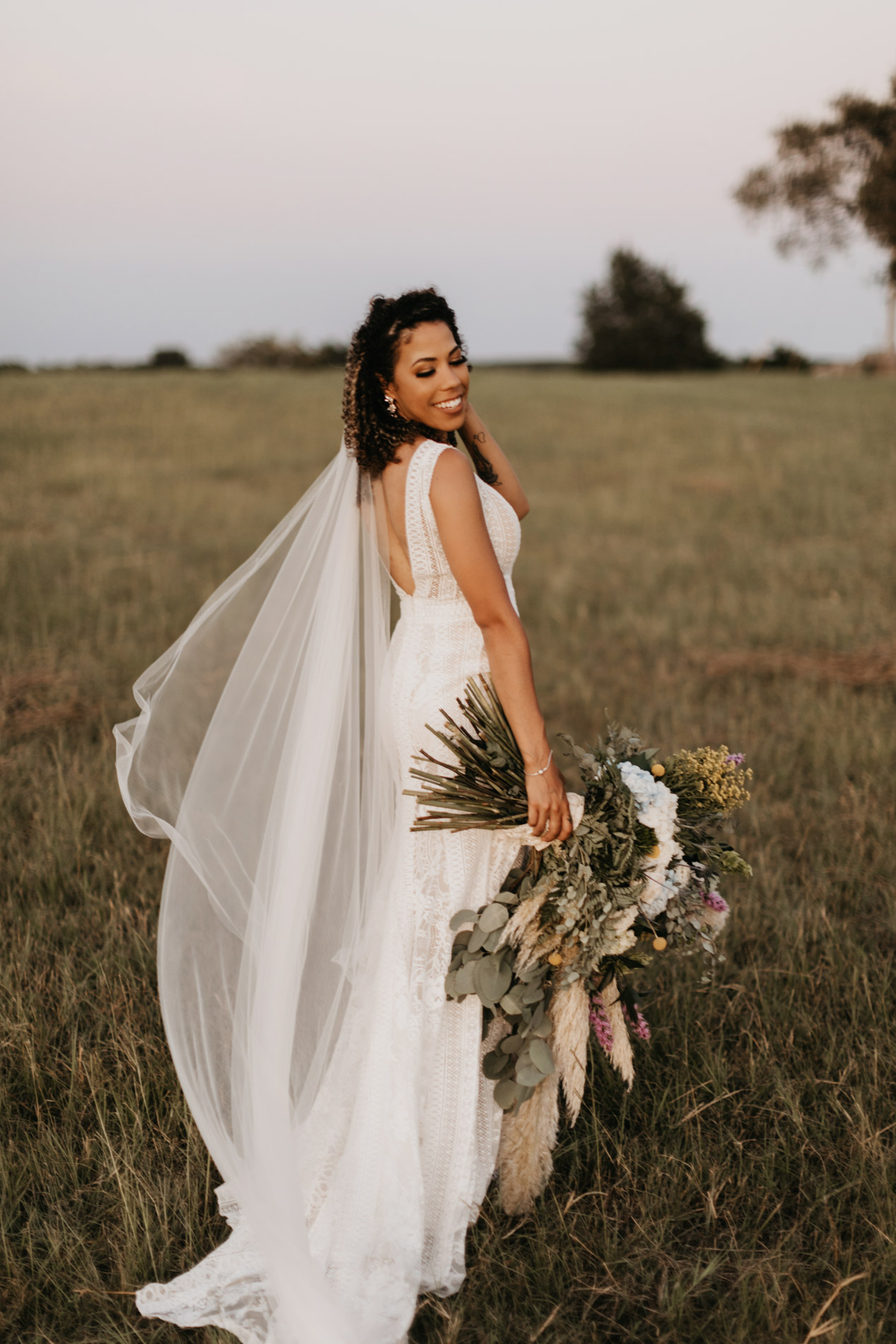 Bride posing for wedding photos on her wedding day