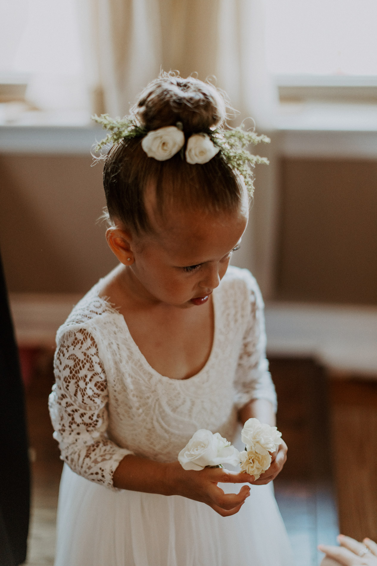 Adorable flower girl dressed up before wedding ceremony