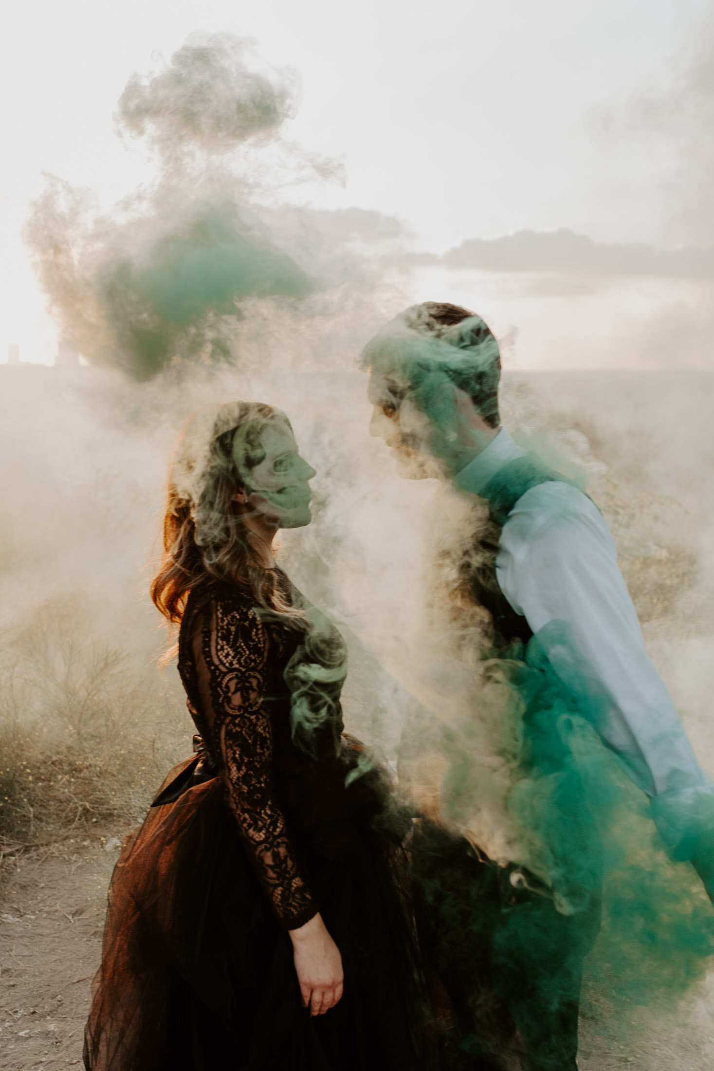 gothic couple shown through green smoke bomb in Fort Worth