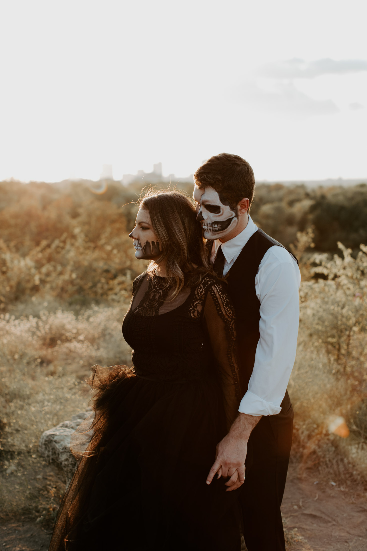 couple wearing skeleton makeup for a day of the dead themed photo shoot