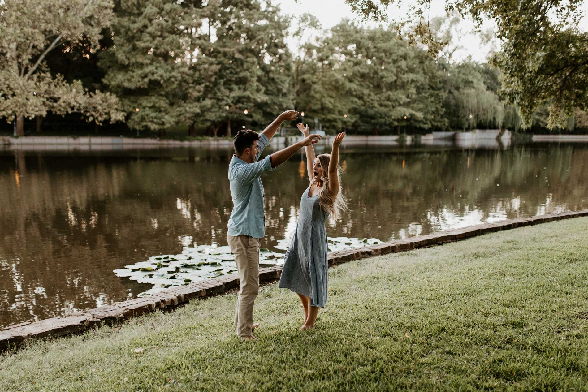 Goofy couple being playful during engagement session in beautiful location