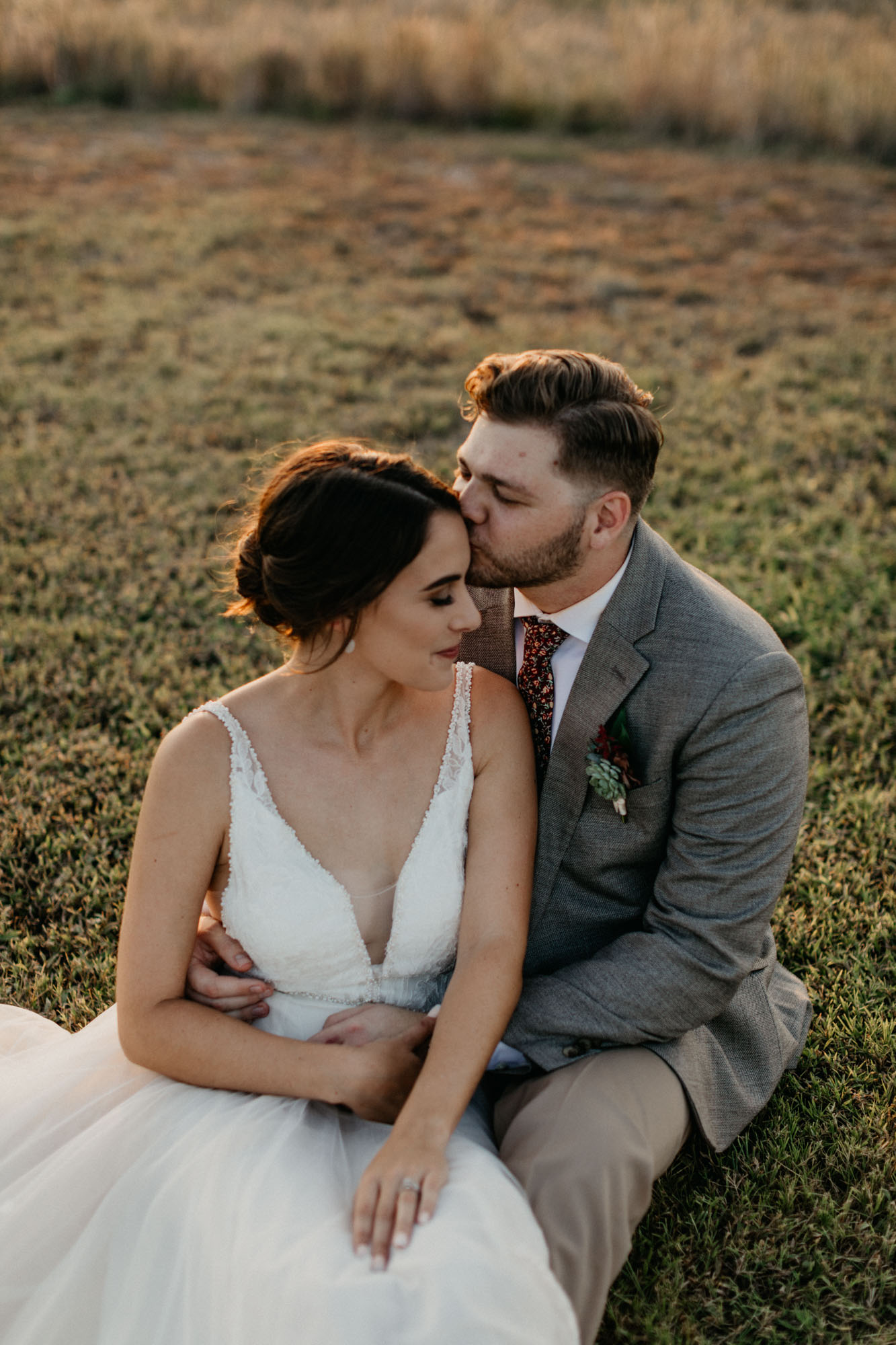 Golden hour photographer takes pictures of bride and groom after their North Texas Wedding Ceremony