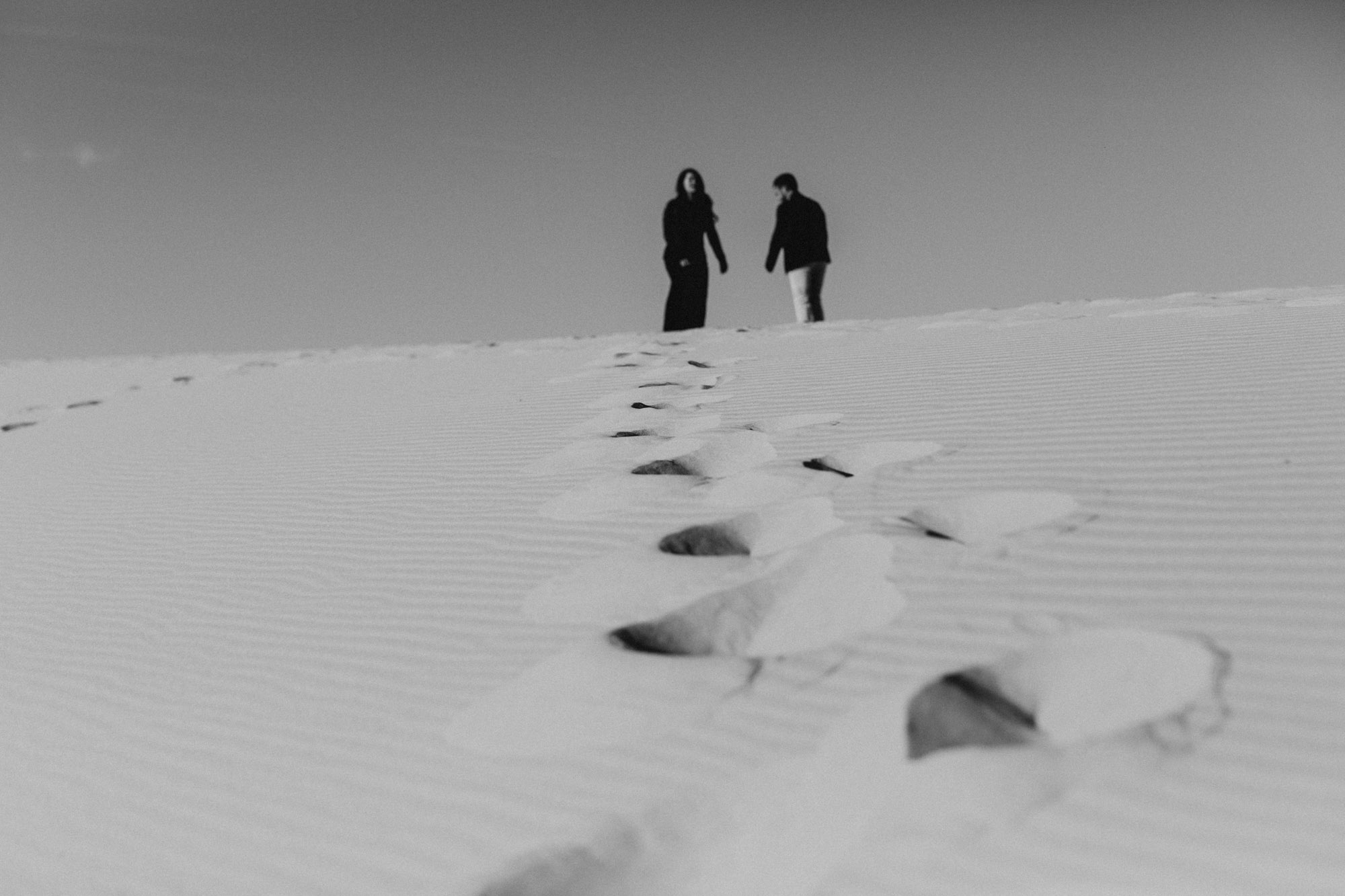 Couple standing on top of a sand hill in Monahans Texas