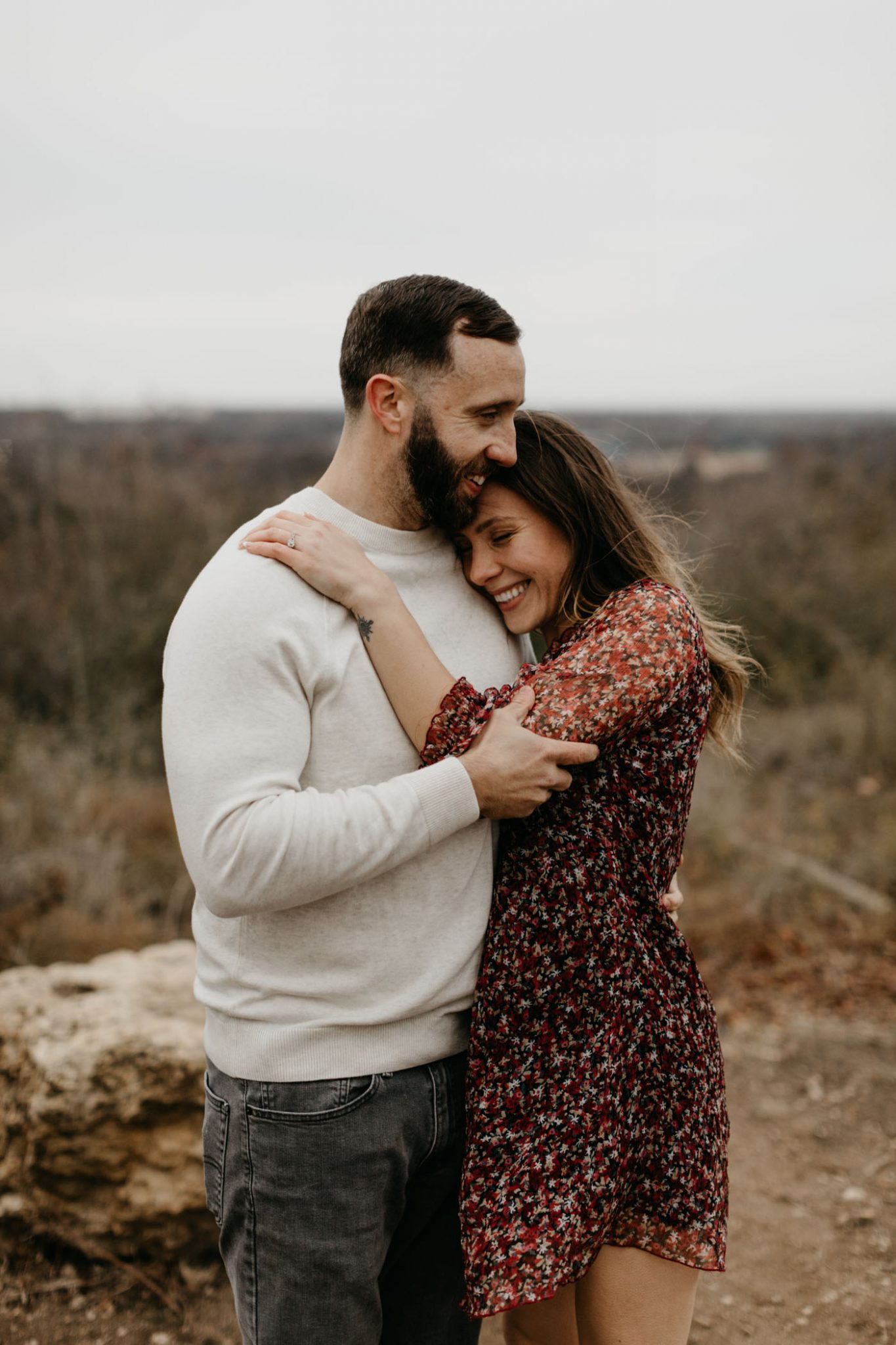 Girl snuggling up to boy in Fort Worth during winter engagement session