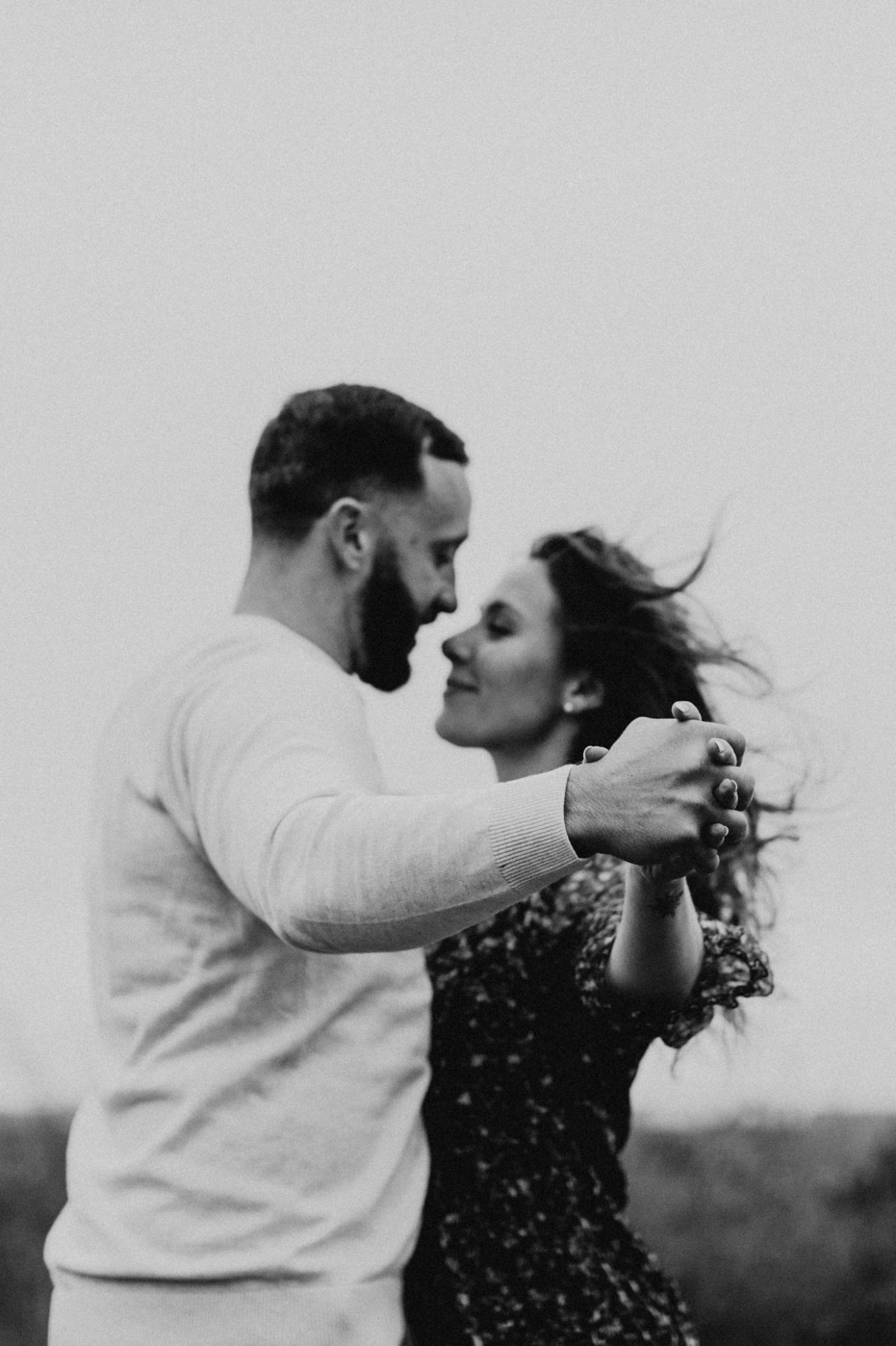 Vintage inspired black and white photo of engaged couple being romantic in Fort Worth
