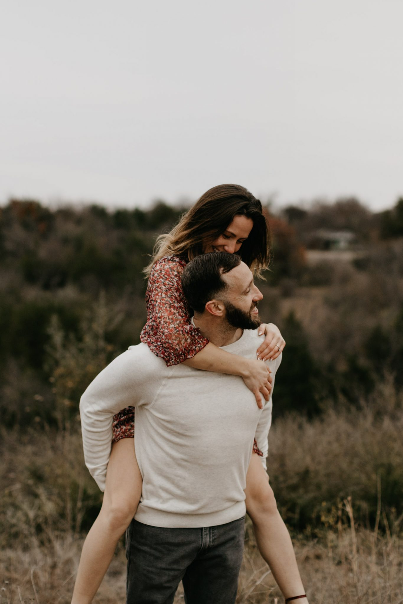 Girl on boys back for playful engagement photos