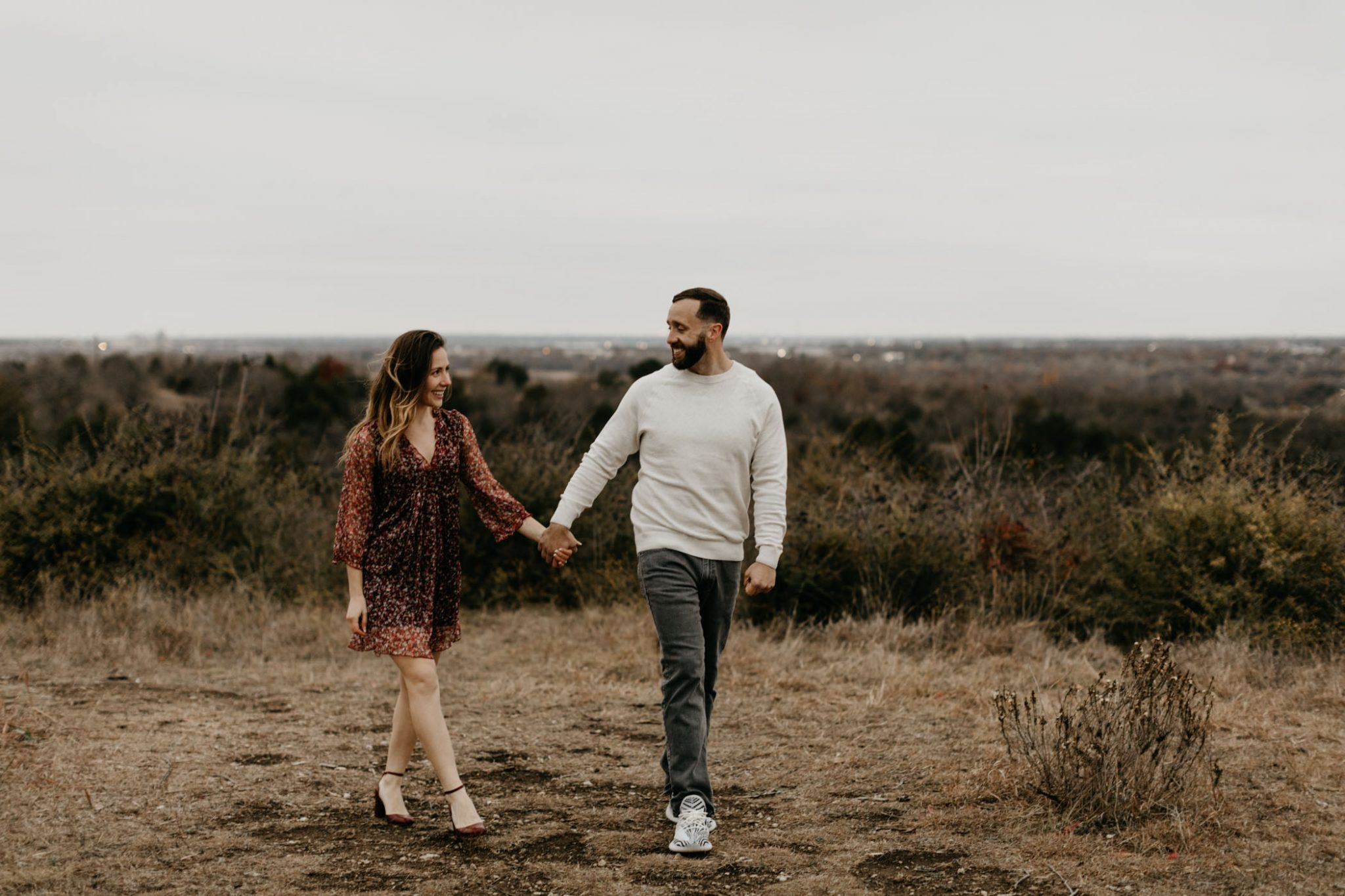 Romantic Fort Worth engagement photographer takes photo of couple walking