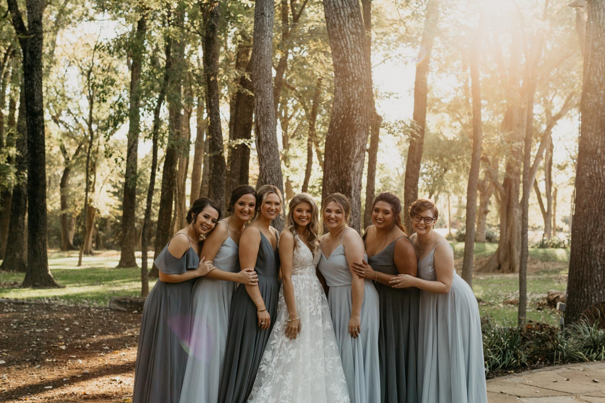 bridesmaids looking at each other during formal photos
