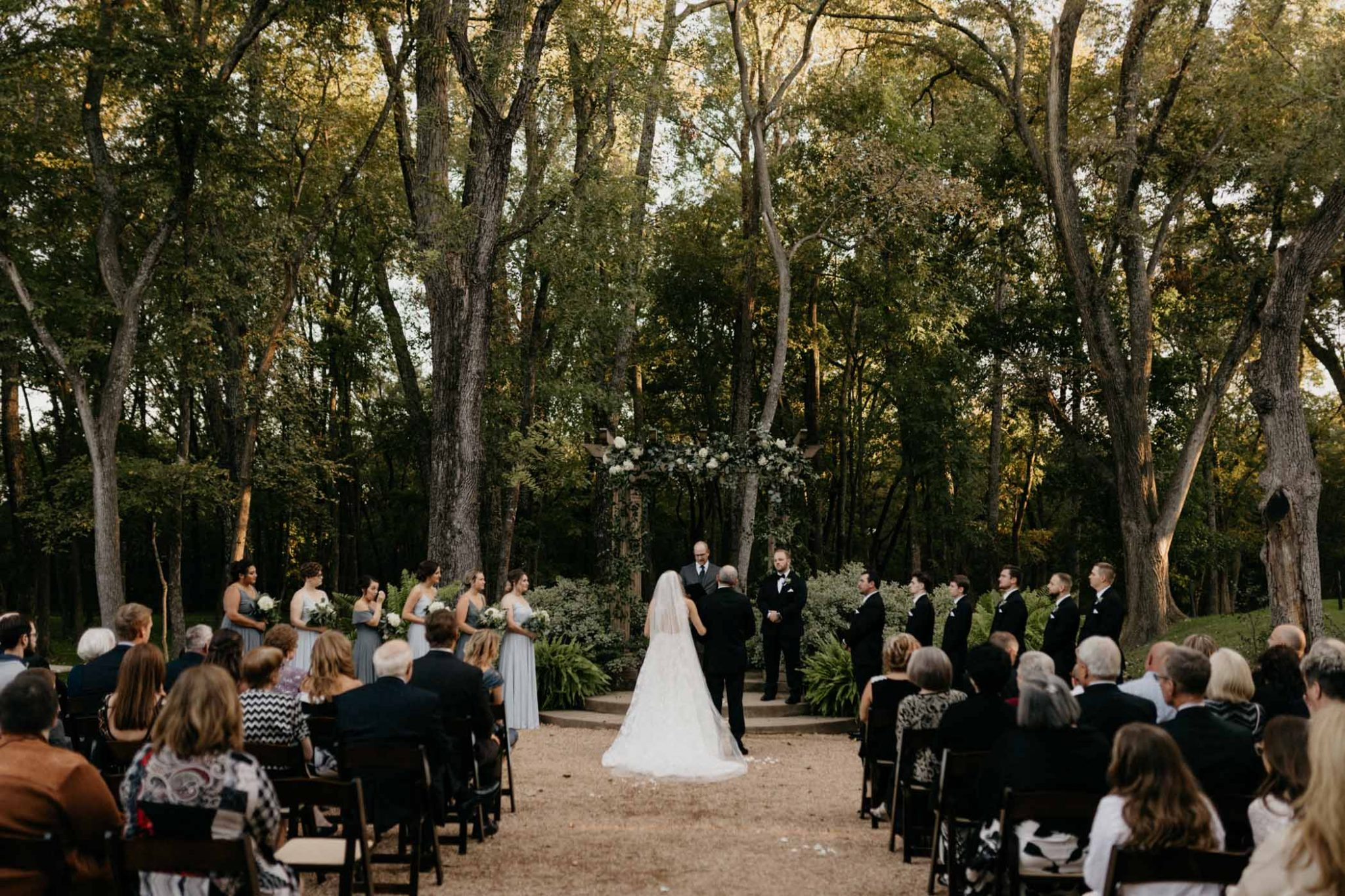 wide angle photo of wedding ceremony outdoors in north texas