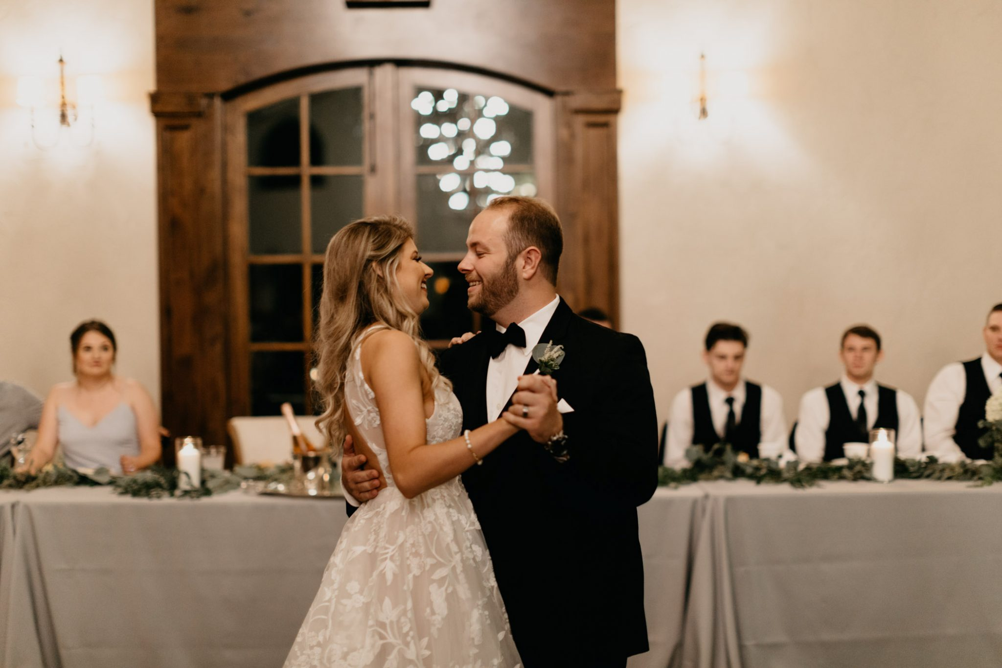 bride and groom first dance at elegant wedding ceremony