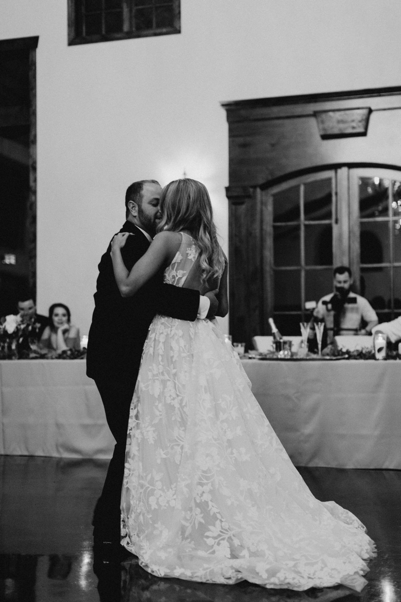 black and white photo of bride and groom sharing their first dance