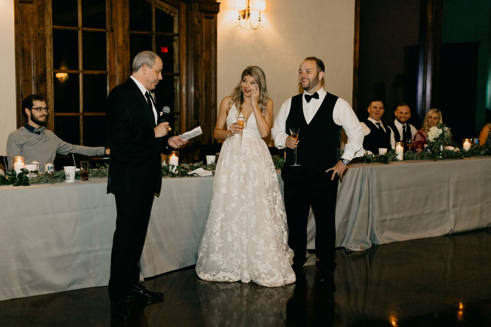 brides dad making a toast and bringing his daughter to tears