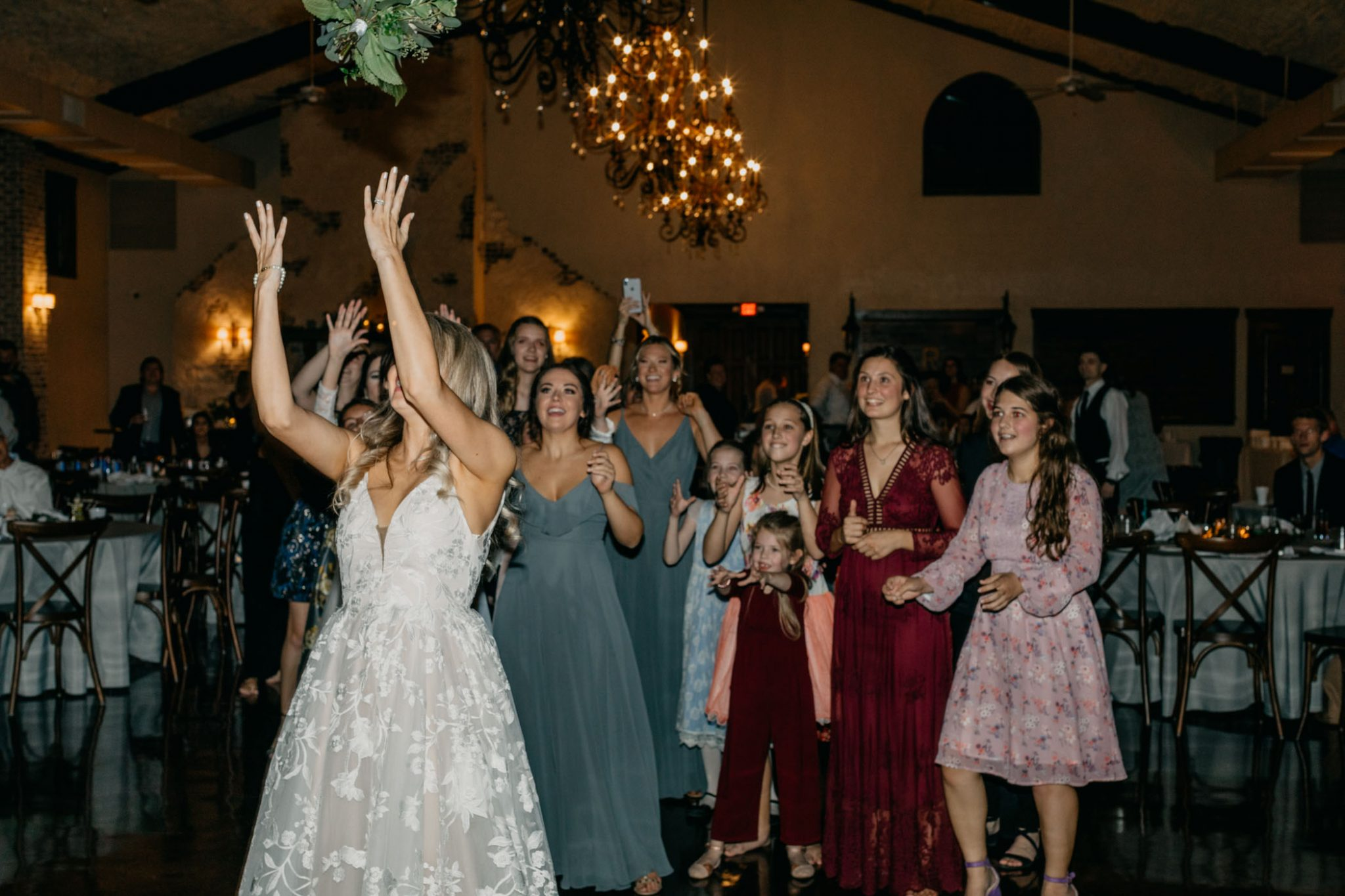 bridal party catching bouquet