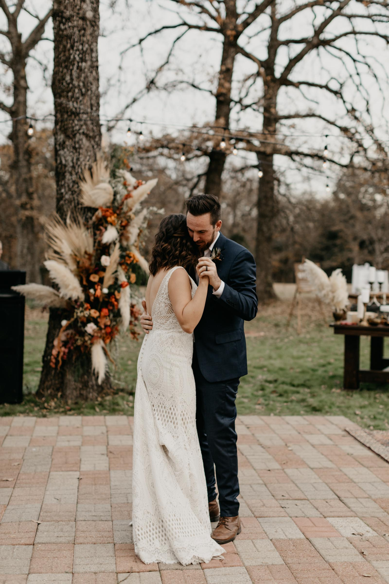 Bride and groom sharing their first dance in Fort Worth at their backyard wedding