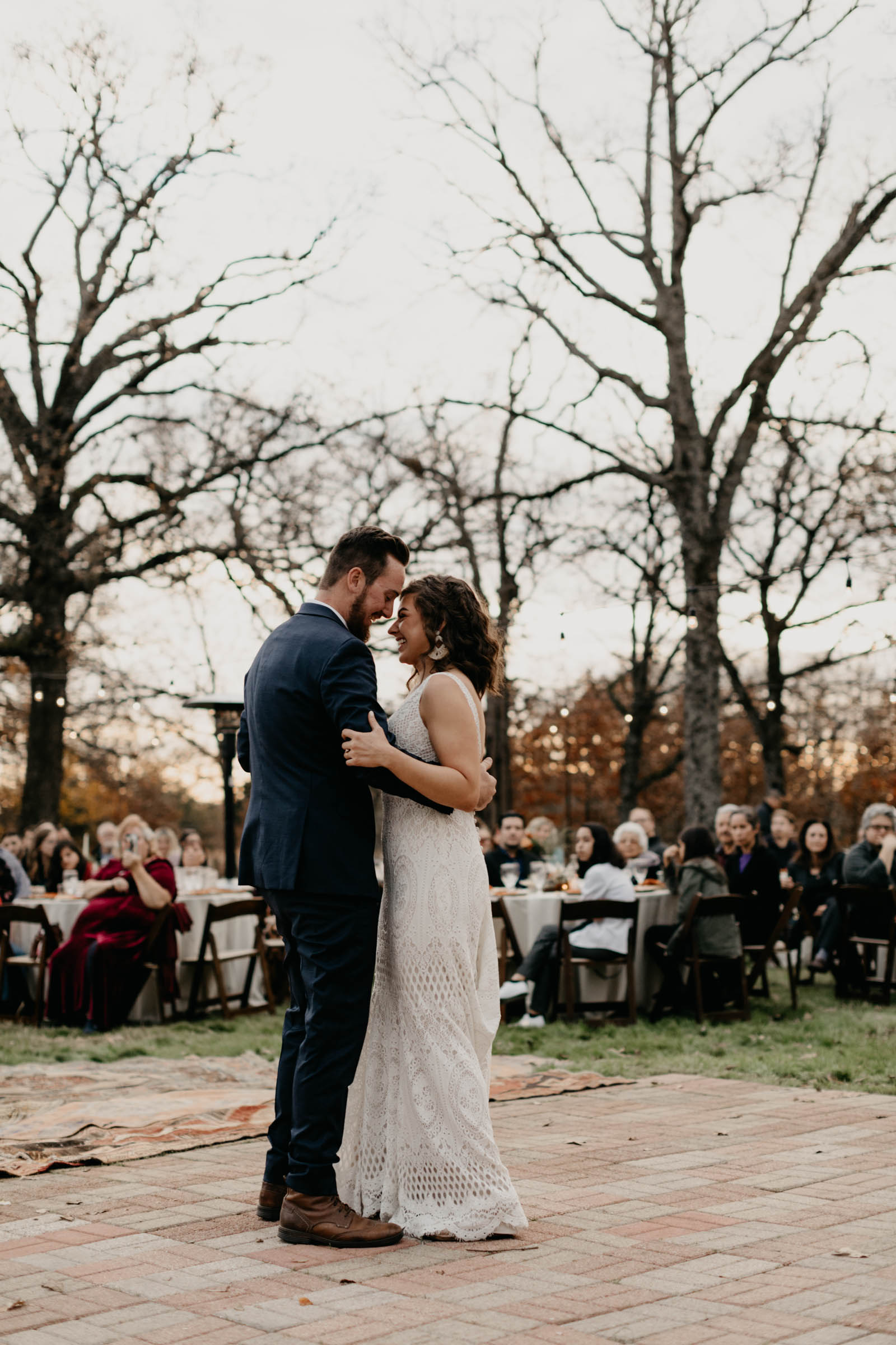 Bride and groom sharing first dance outdoors on their backyard porch