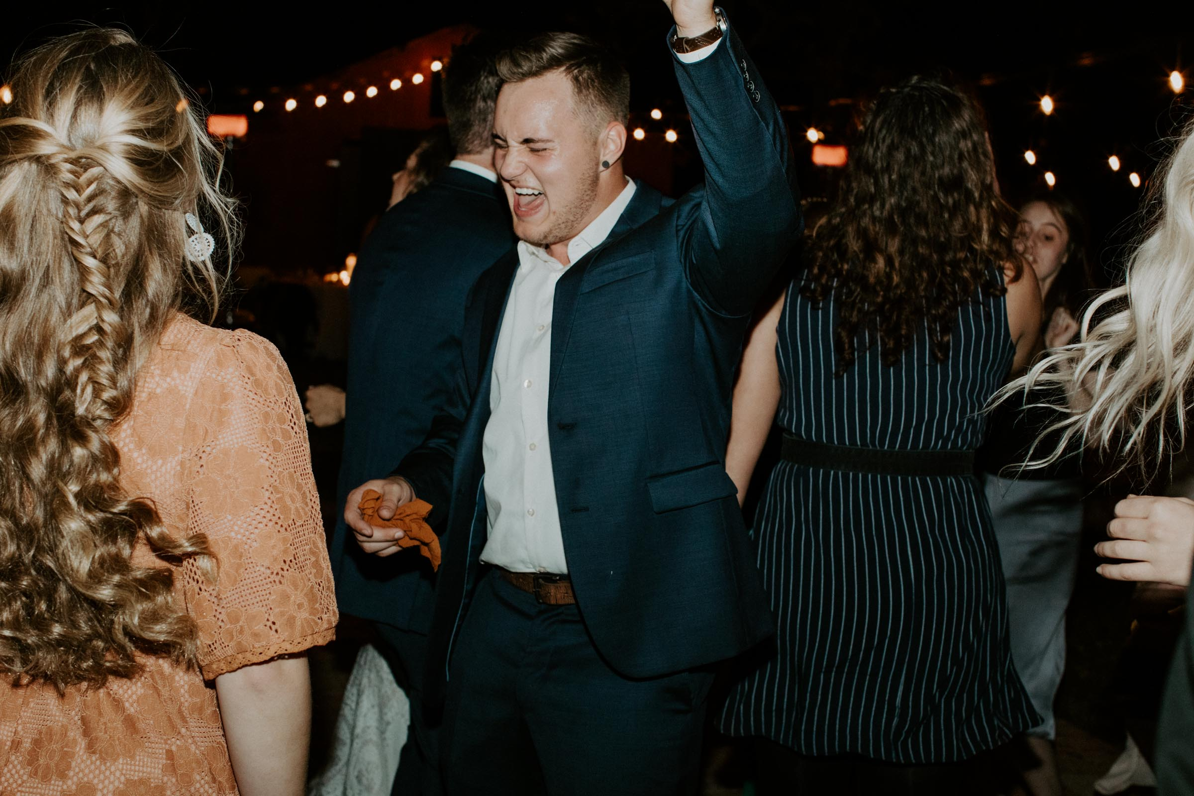 Groomsmen dancing at her wedding day