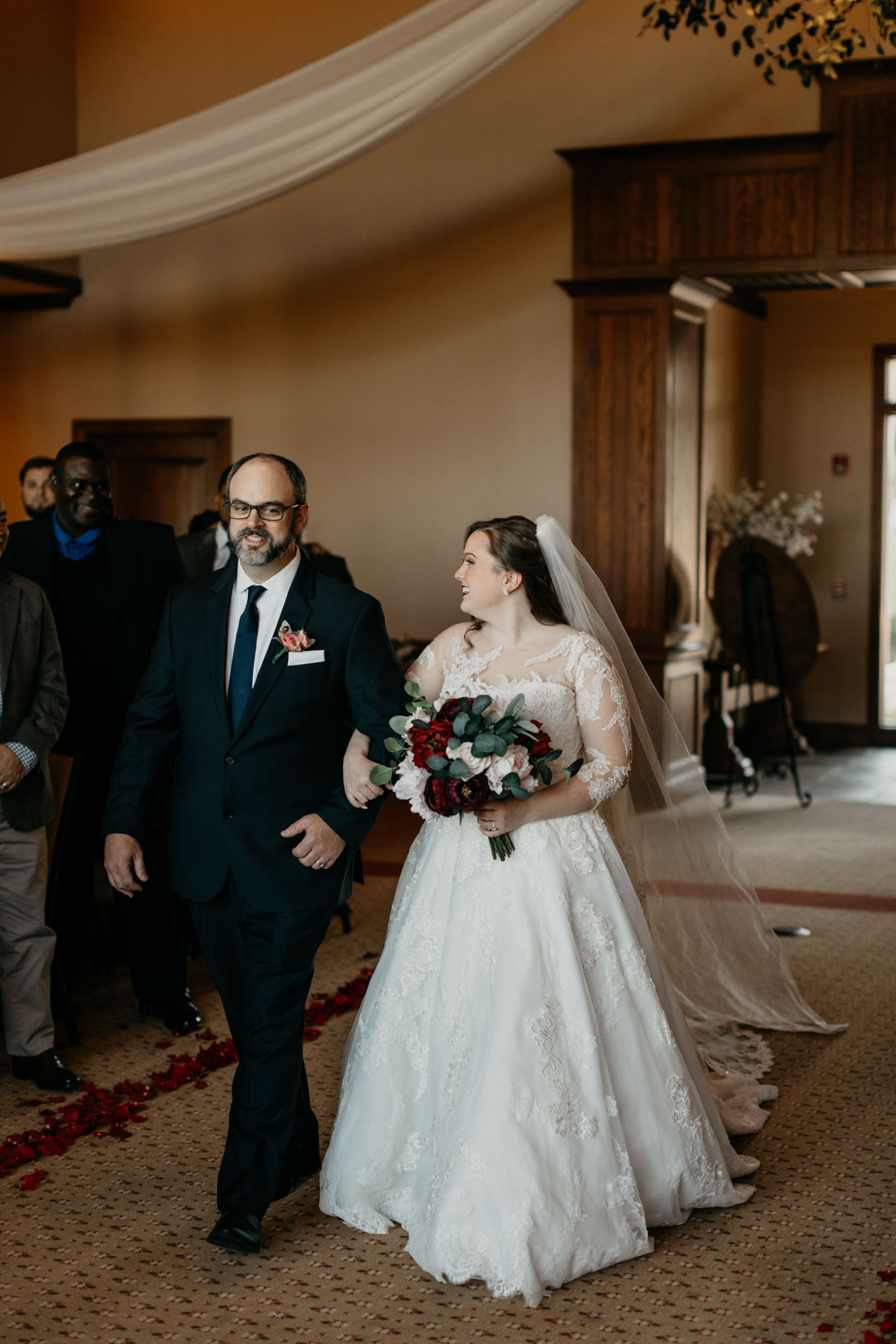stunning bride walking down the aisle in a line princess dress