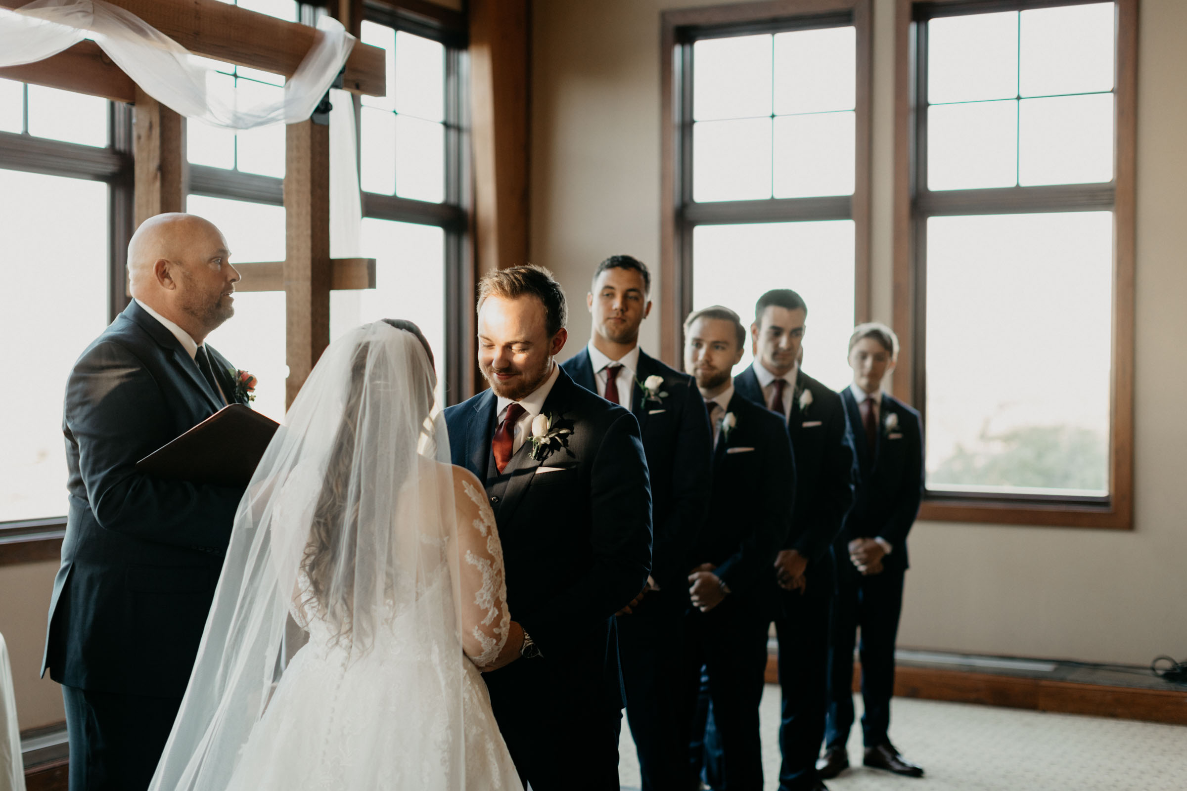 Bride and groom looking at eachother on their wedding day in Dallas