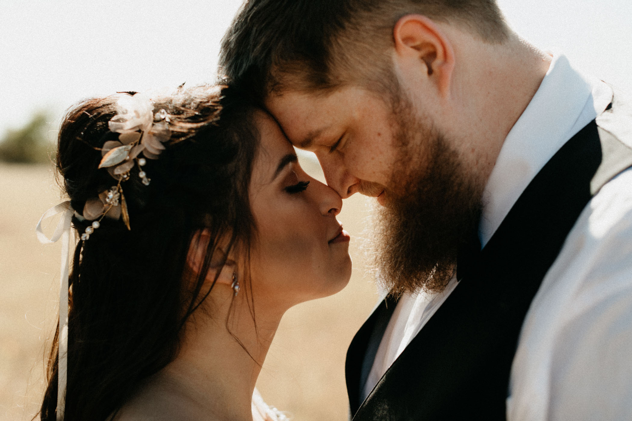 bride and groom putting foreheads together for romantic wedding photo