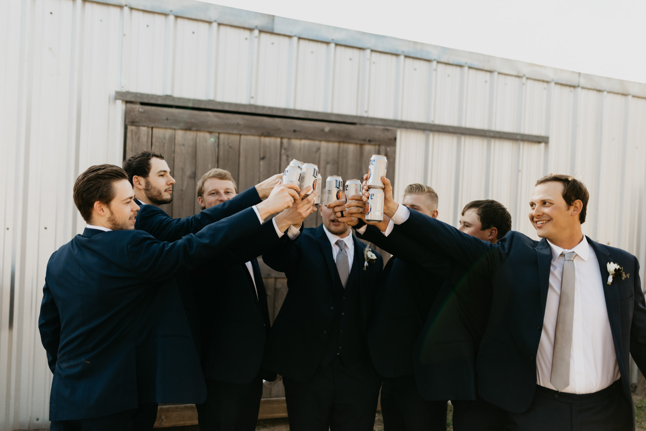 groomsmen drinking beer and toasting before ceremony