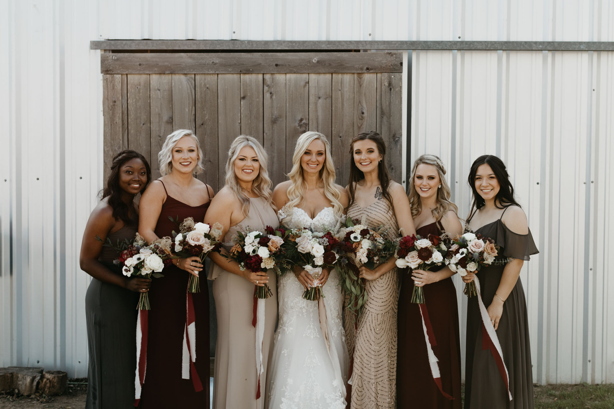 bridesmaids wearing mix matched dresses and taking portraits before ceremony