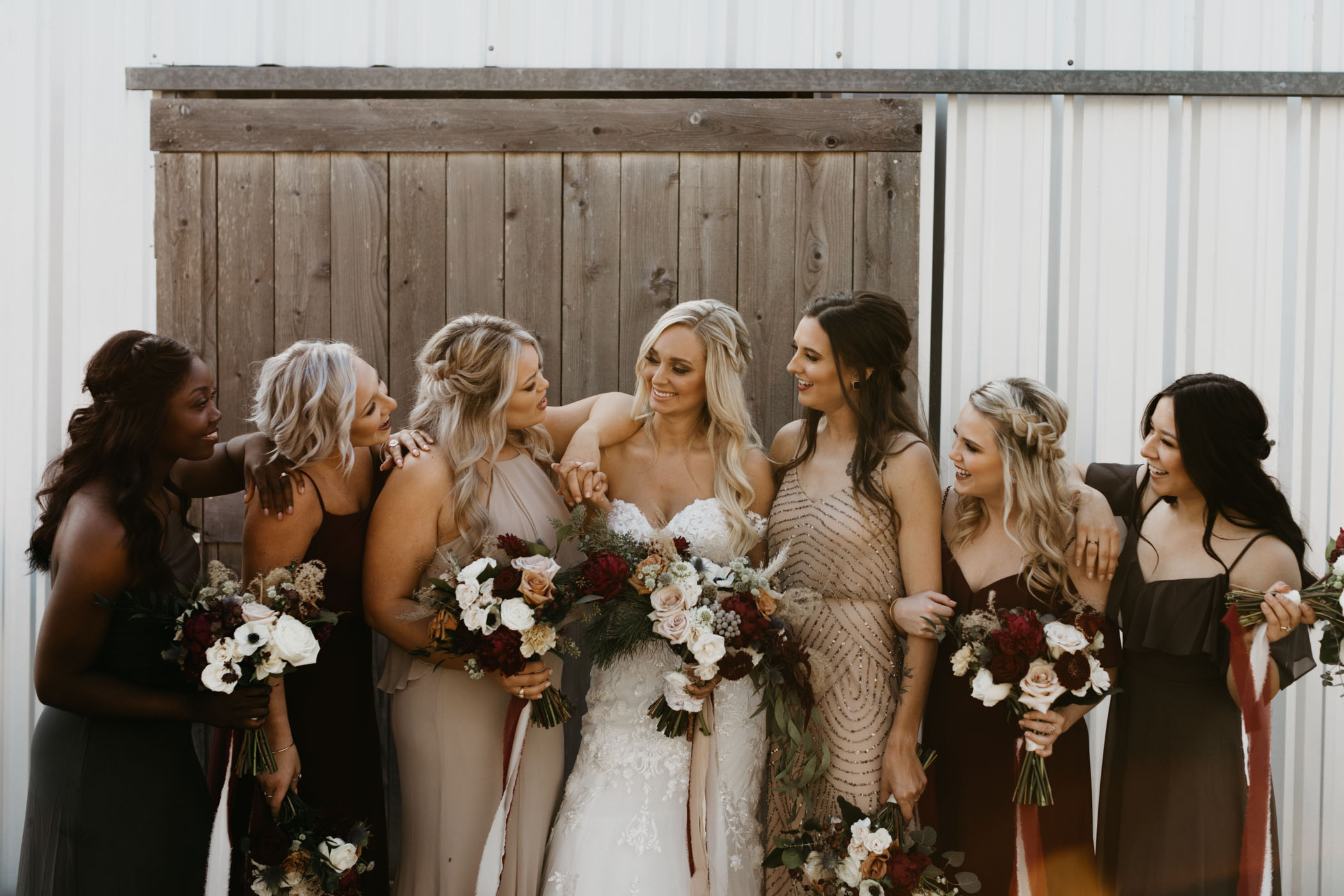 bridesmaids laughing and spending time together before the wedding ceremony starts
