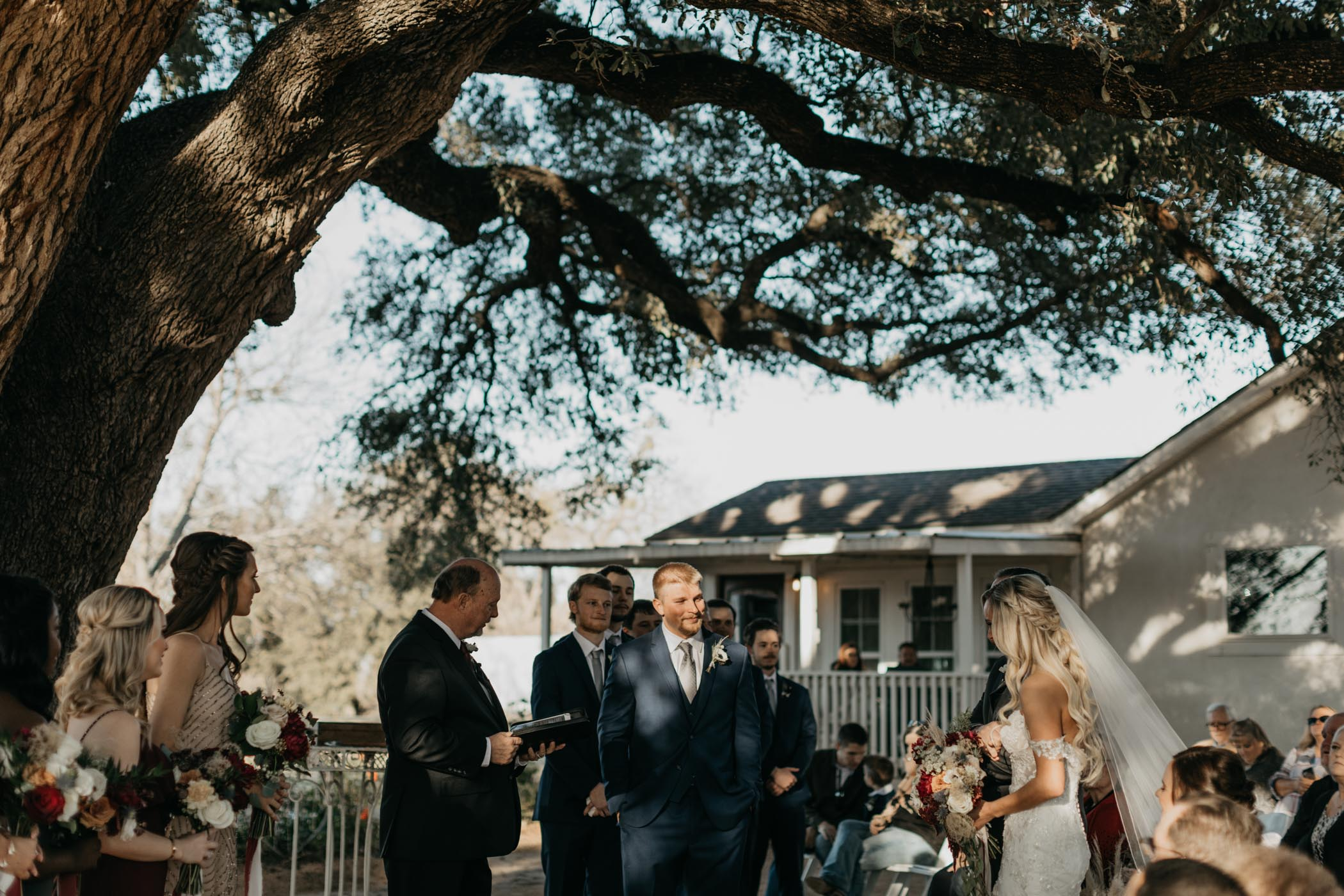 brides father giving her away at their outdoor wedding ceremony in Texas