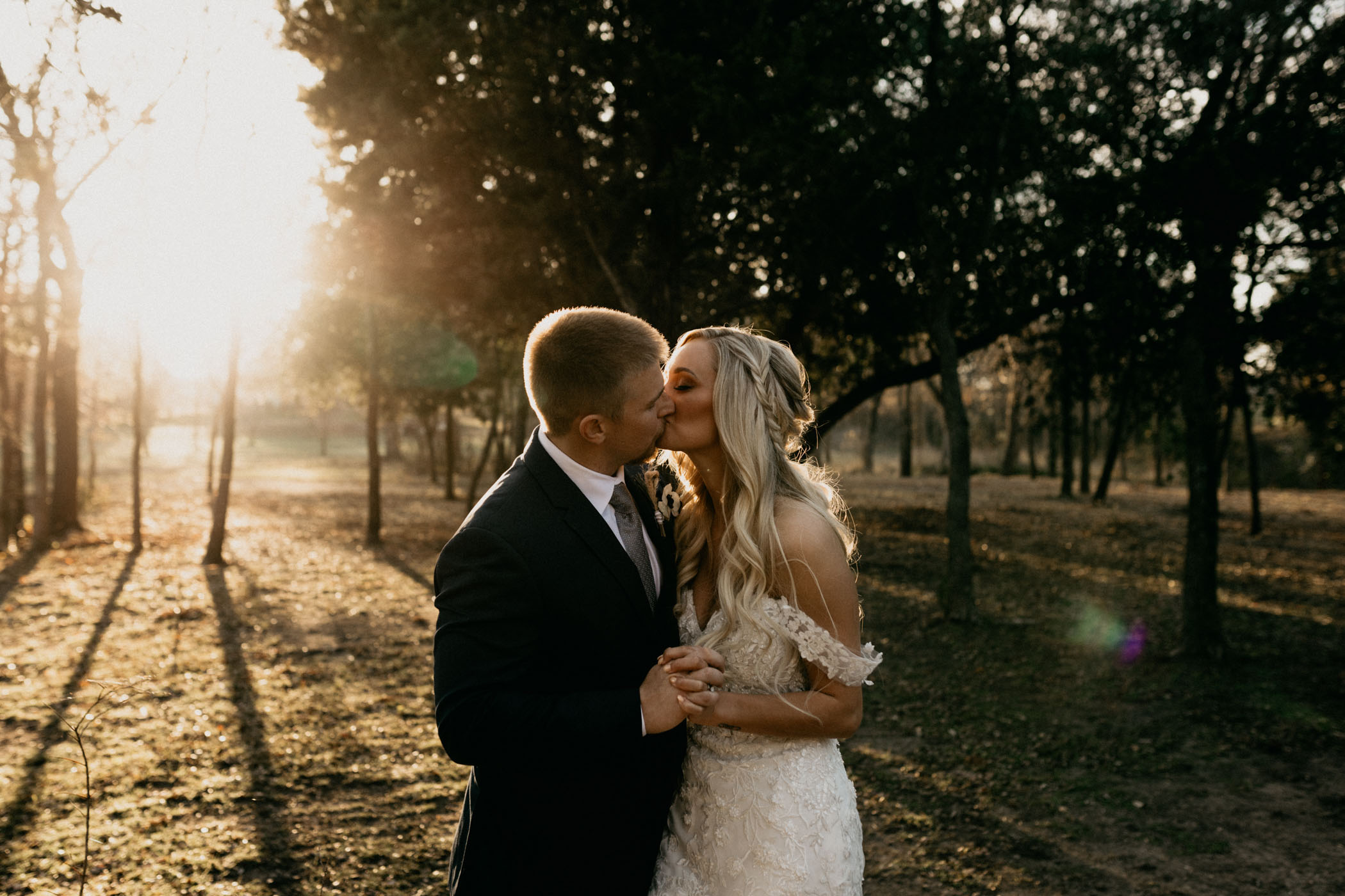 winter wedding day bride and groom portraits at golden hour