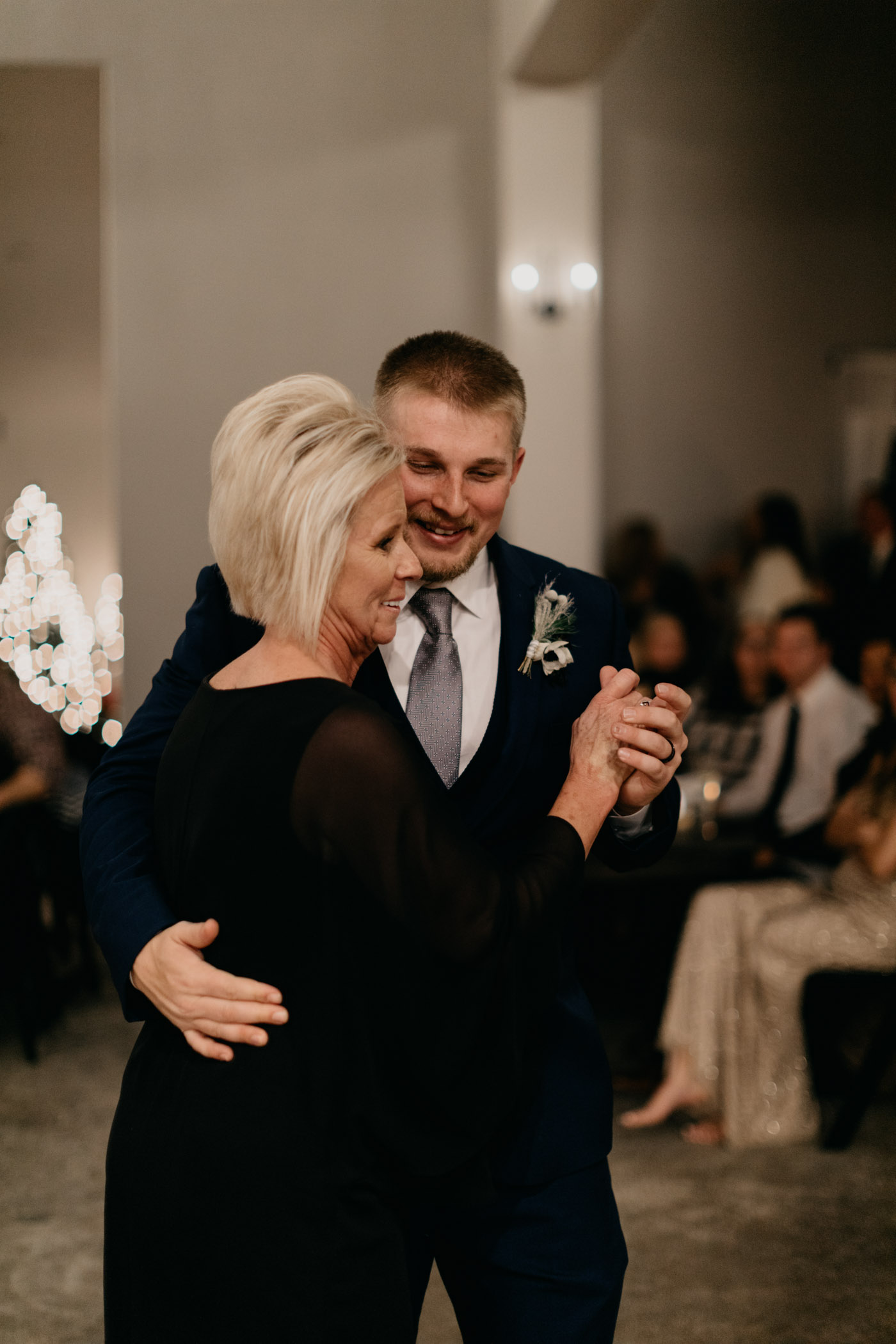 groom dancing with his mother on winter wedding day