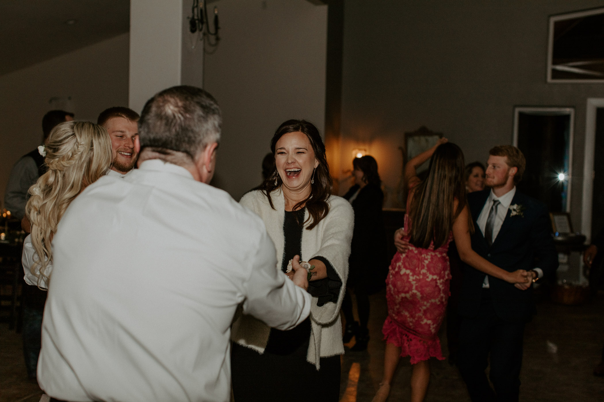 brides mom dancing with dad on winter wedding day