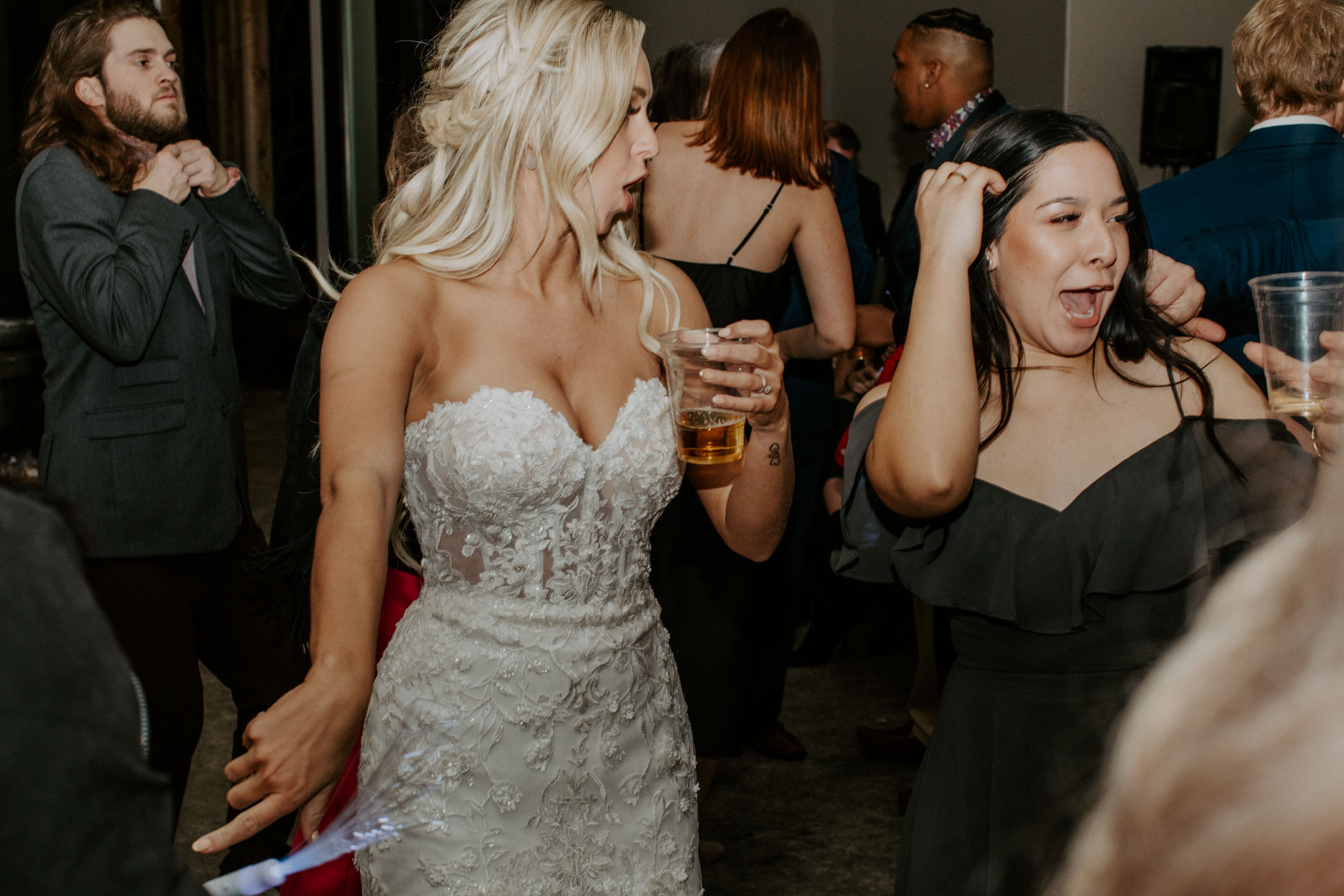 bride drinking and dancing on wedding day