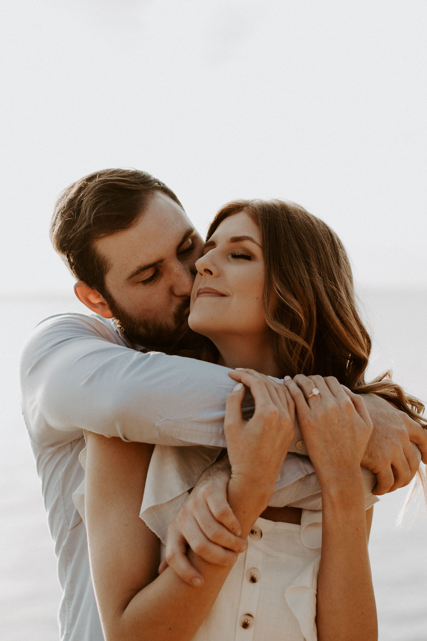 boy hugging girl from behind for engagement session in Fort Worth