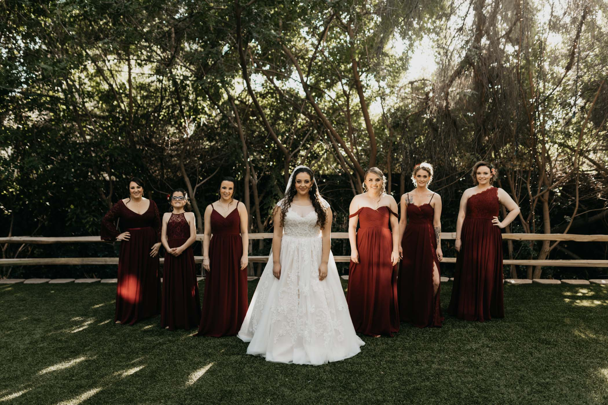 Bridesmaids and bride take moody photo together at Green gables wedding estate