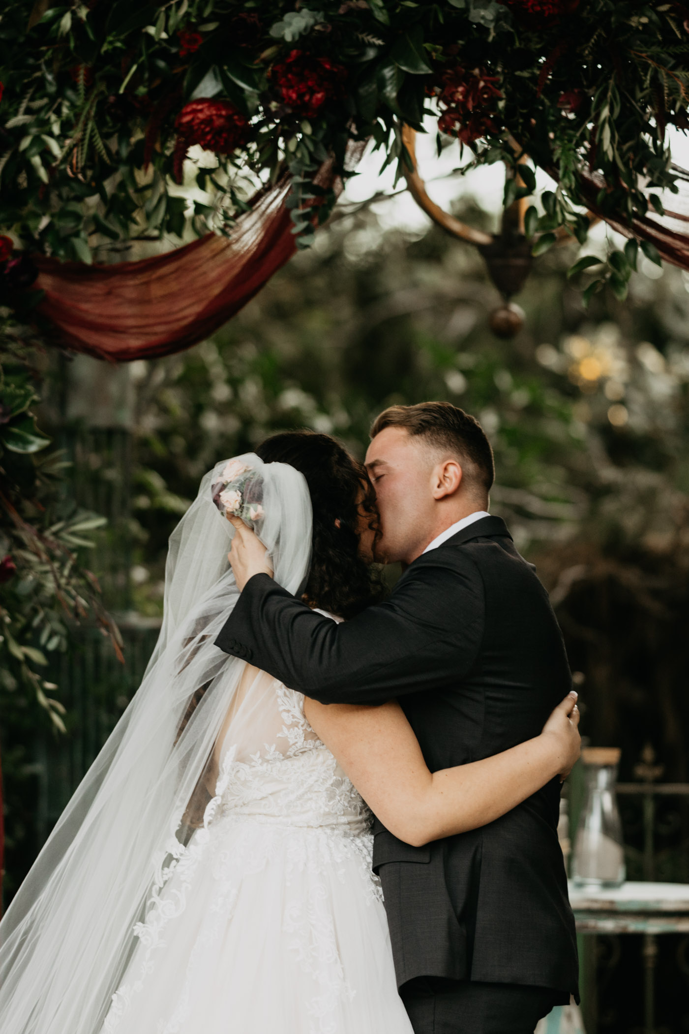 Bride and groom kissing for the first time on their wedding day