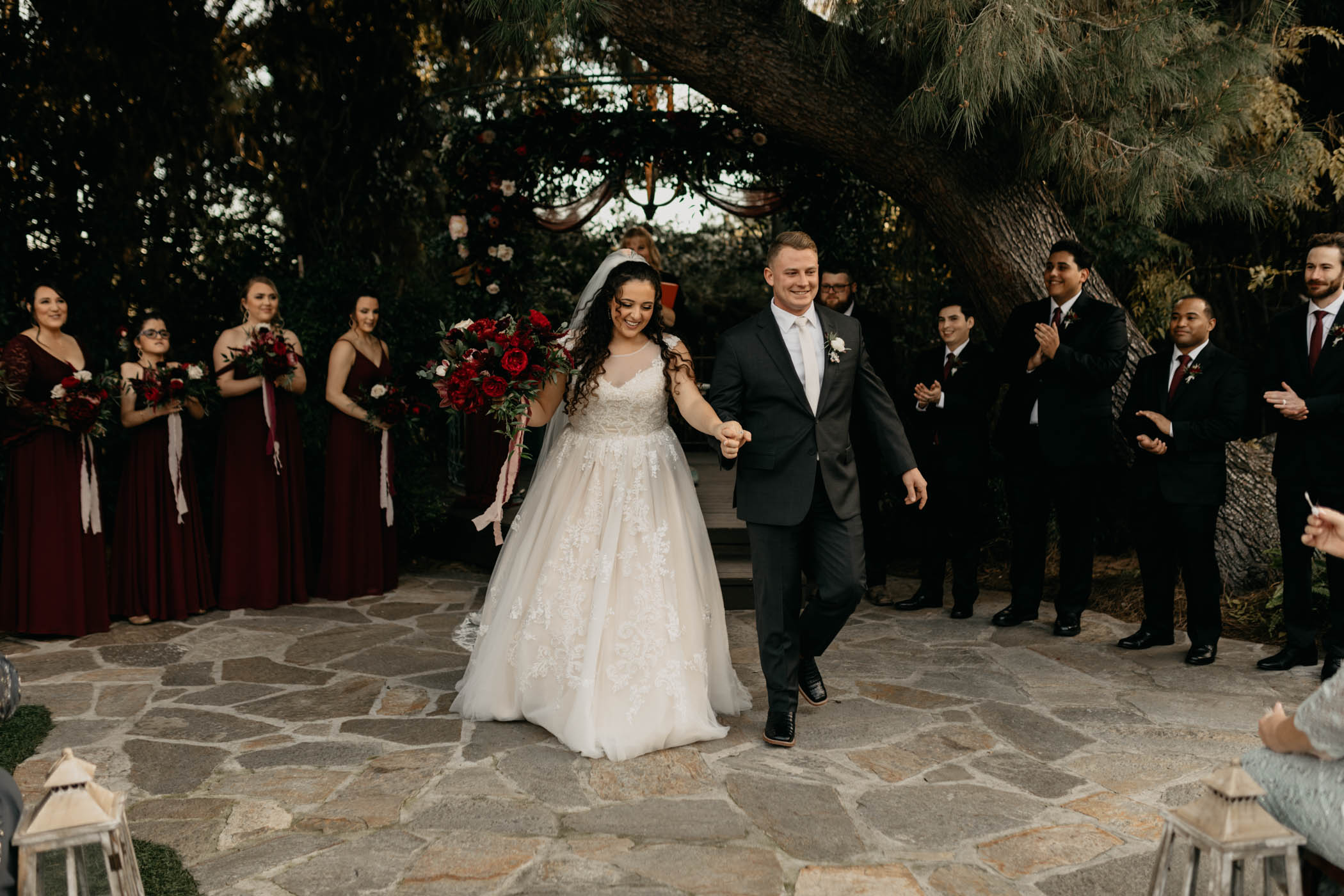 Bride and groom leaving their wedding ceremony in California smiling