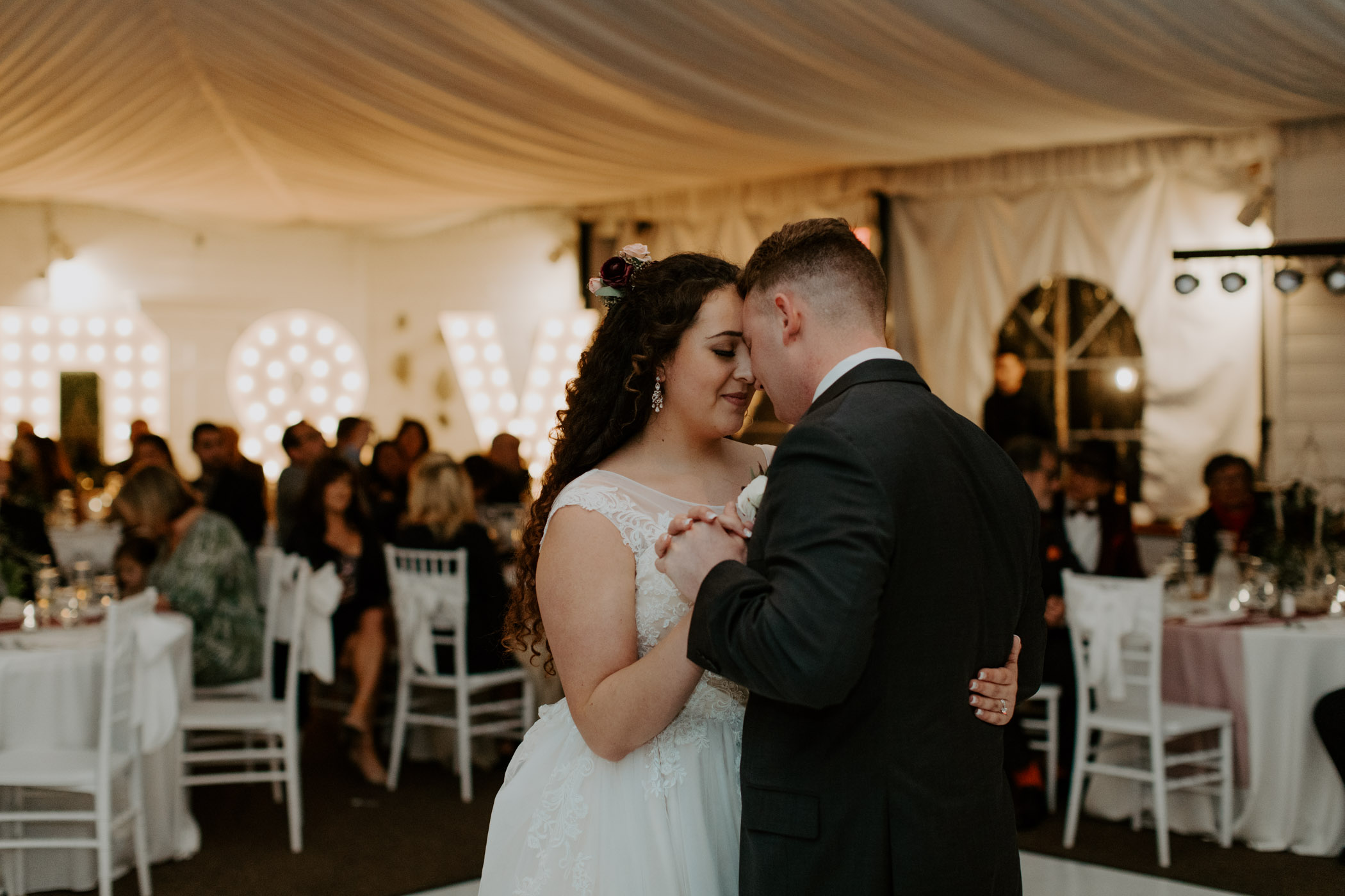 Bride and groom sharing first dance and being romantic