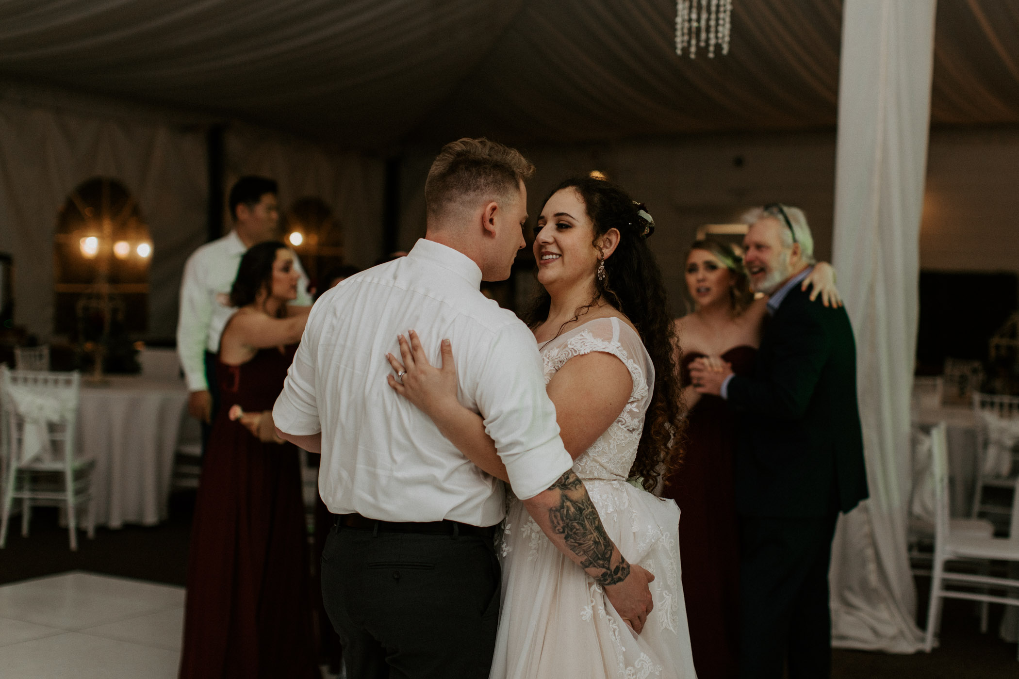 Bride and groom dancing at their California wedding reception