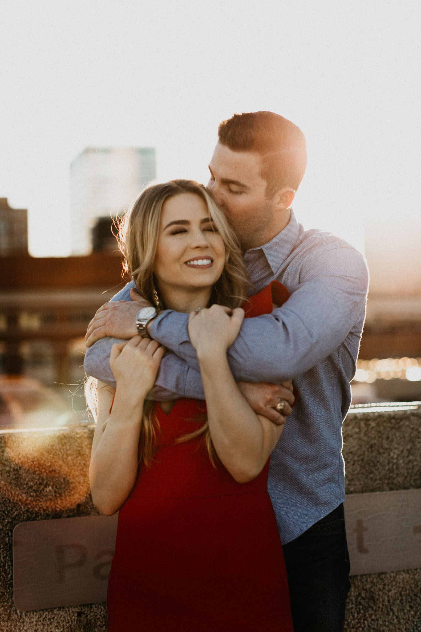 Engaged couple cuddling during their downtown Fort Worth engagement session
