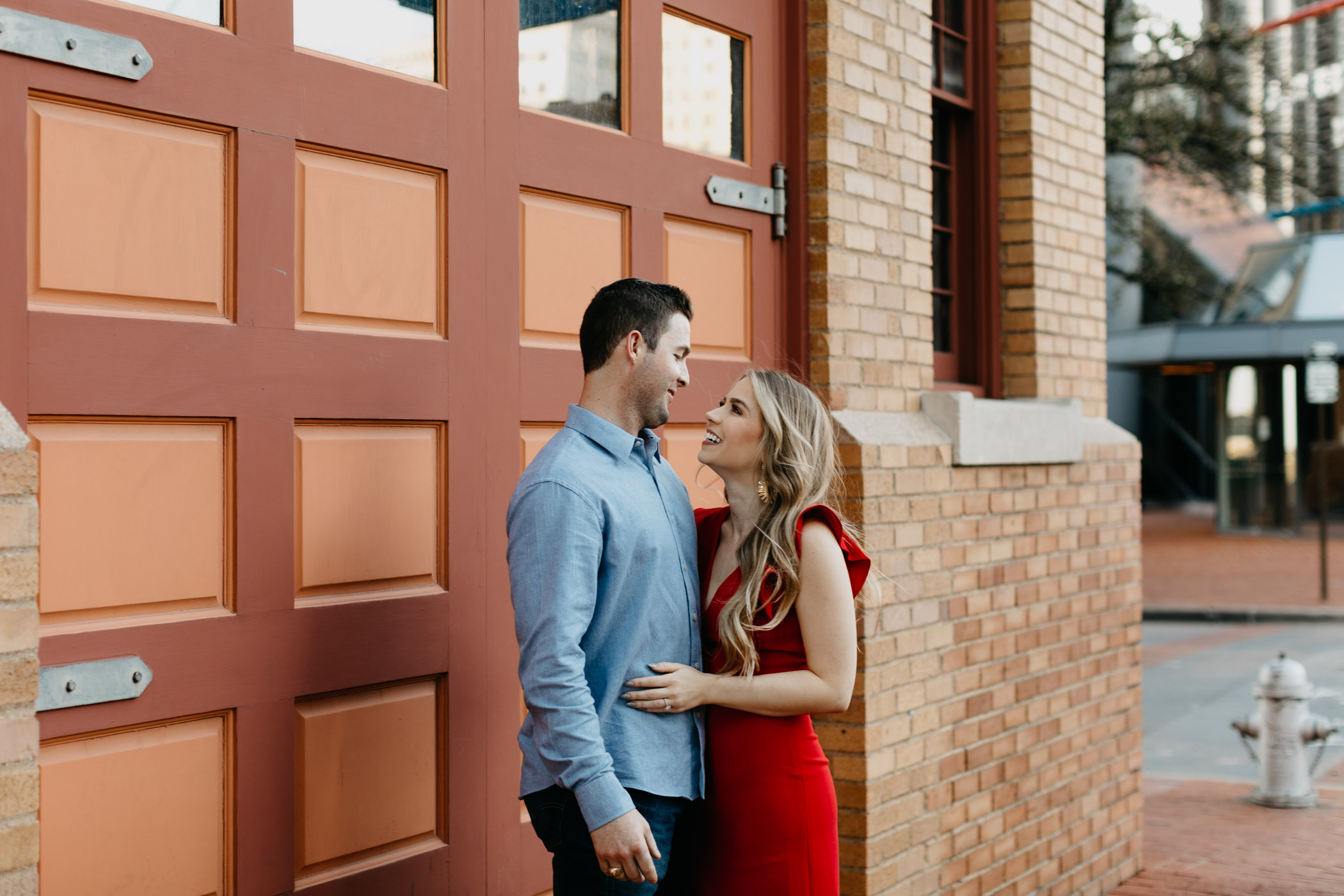Adorable engaged couple taking photos in downtown Fort Worth