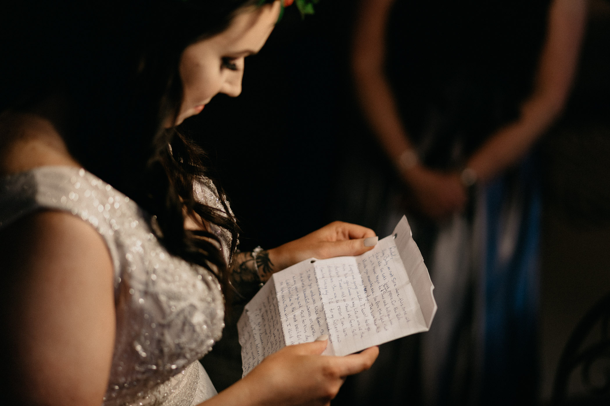 Bride reading a letter that her groom wrote her before their wedding day