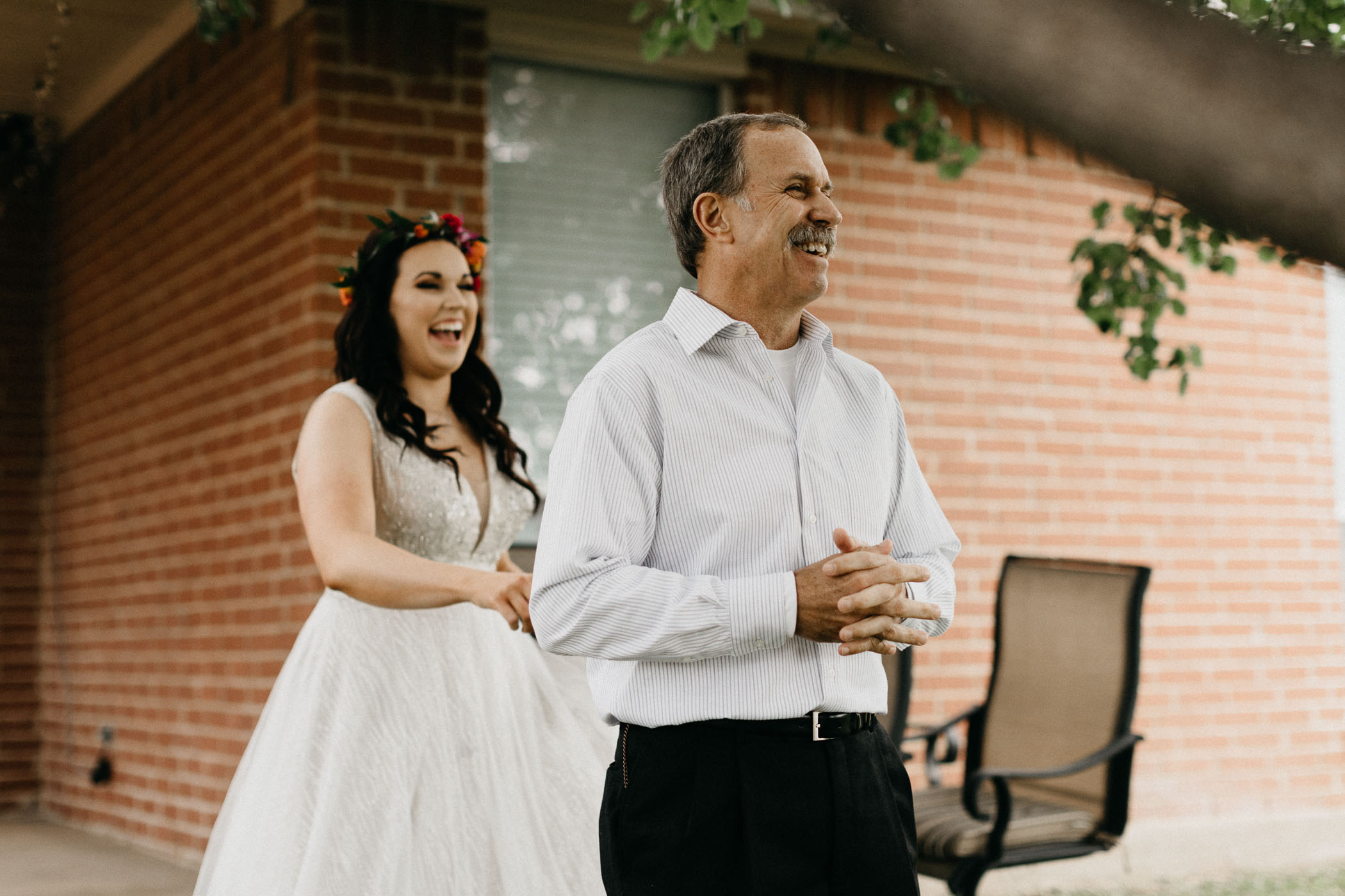 Father of the bride about to see her for the first time for an emotional moment