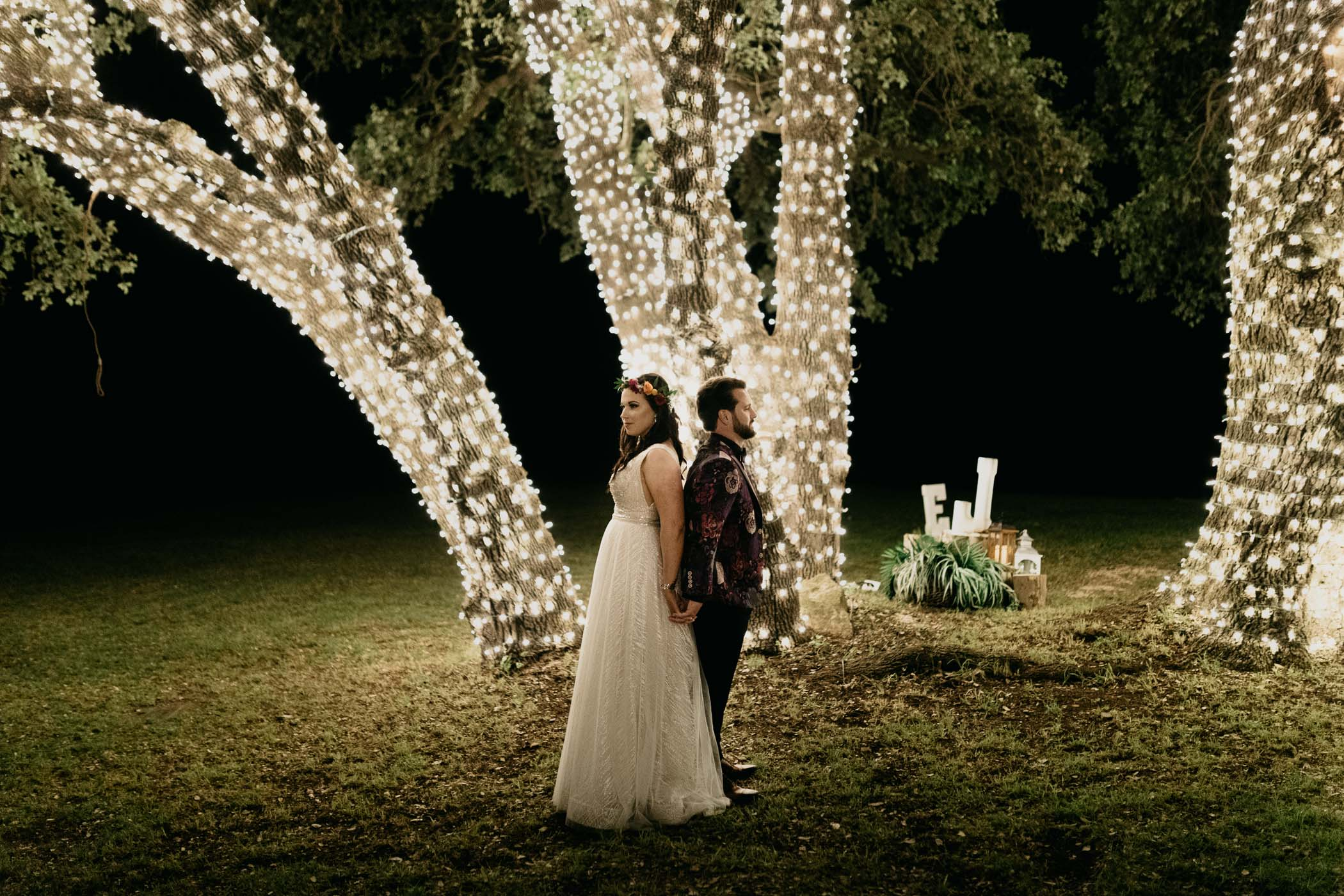 Moody string lights bride and groom portraits