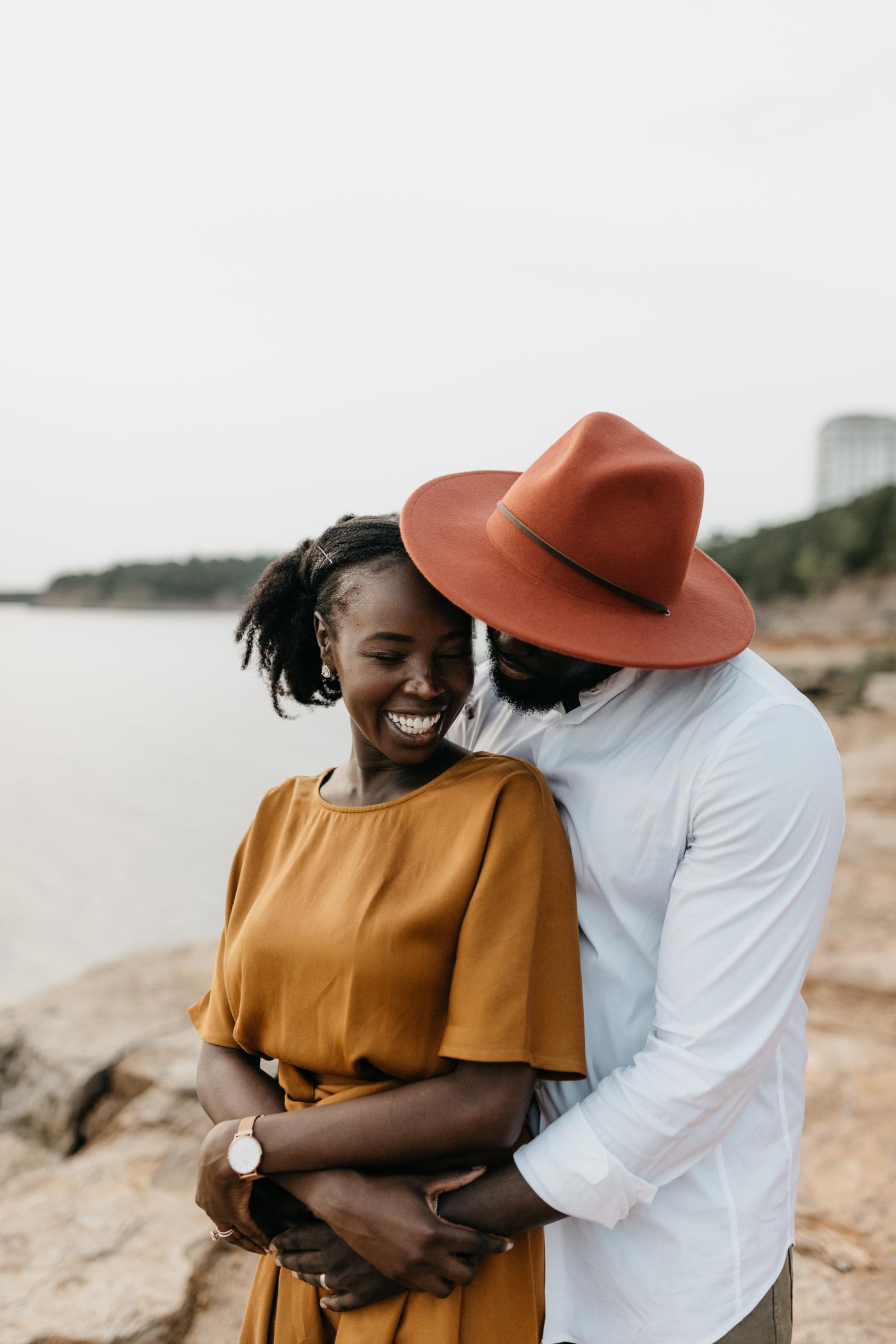 boho couple cuddling during anniversary photo session
