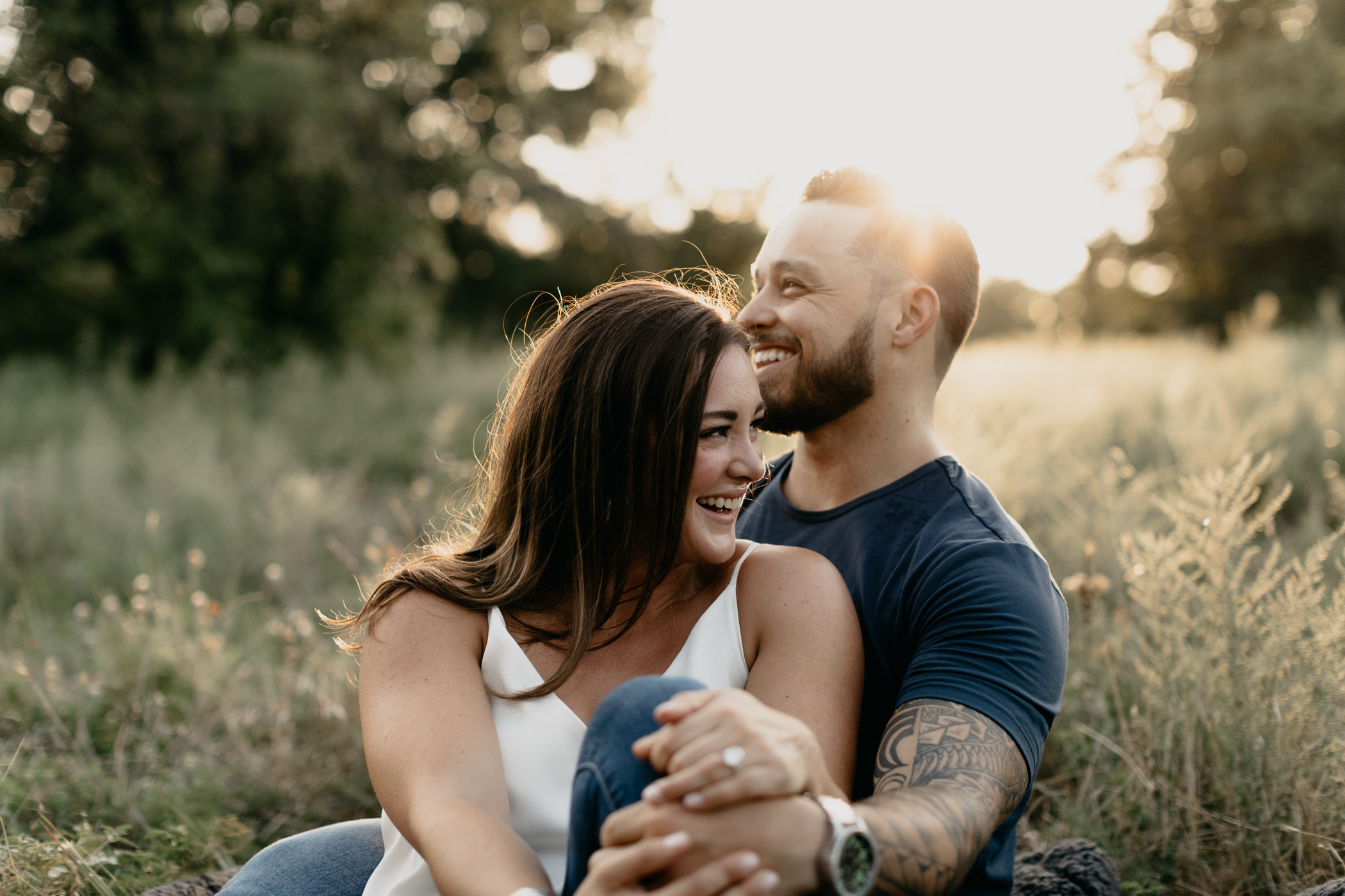 playful couple laughing during engagement session in Fort Worth